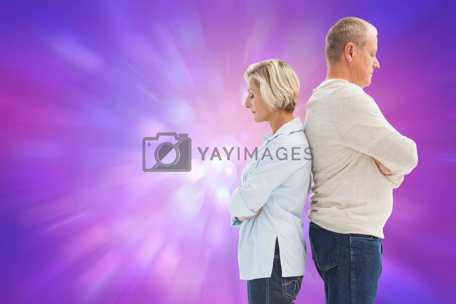 Unhappy couple not speaking to each other  against purple abstract light spot design