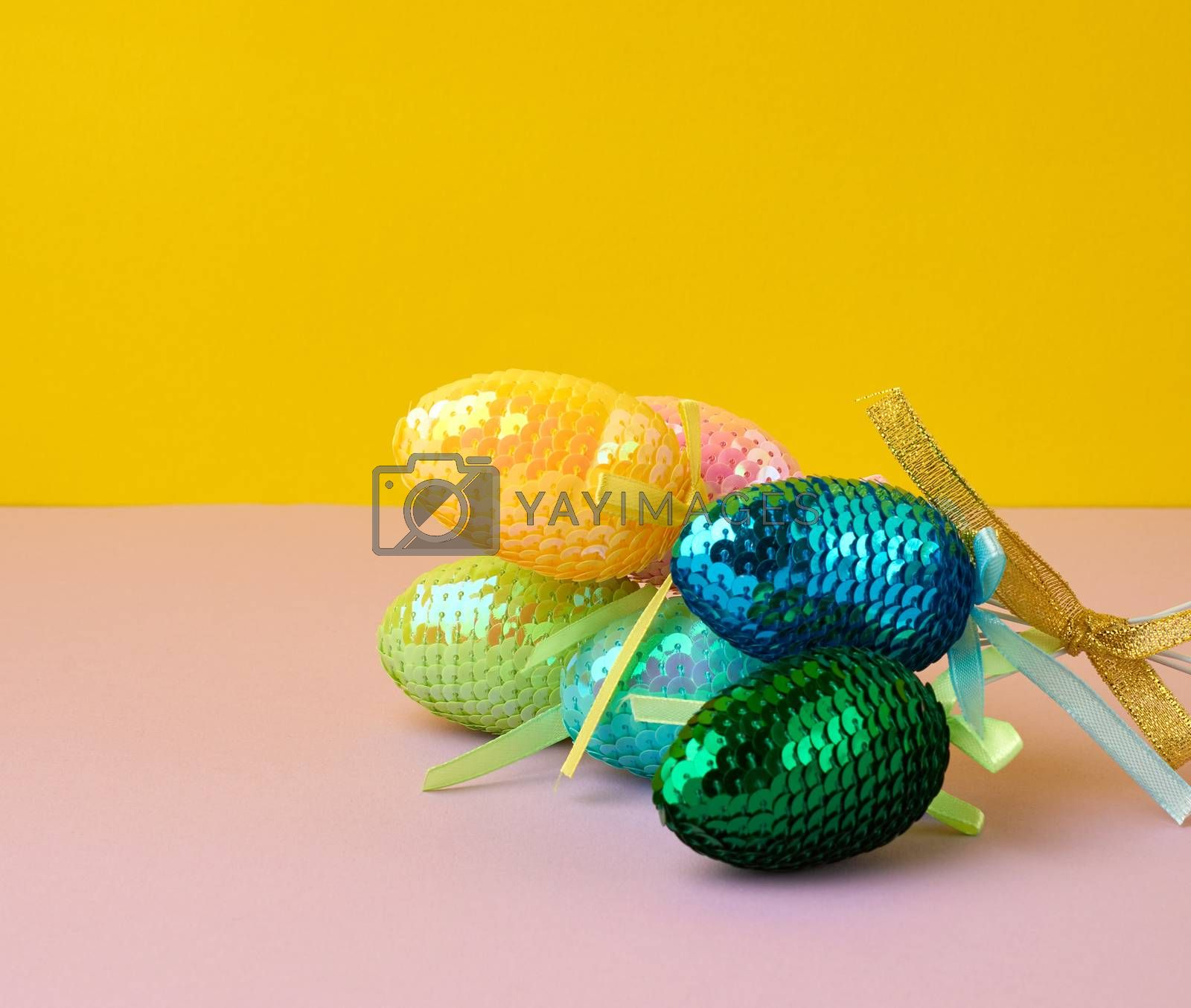 multicolored decorative Easter eggs decorated with sequins on a  by ndanko