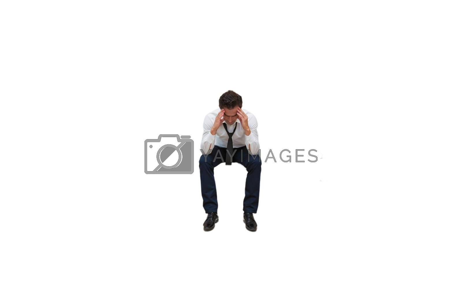 Cutout of stressed and overworked businessman sitting   by moodboard