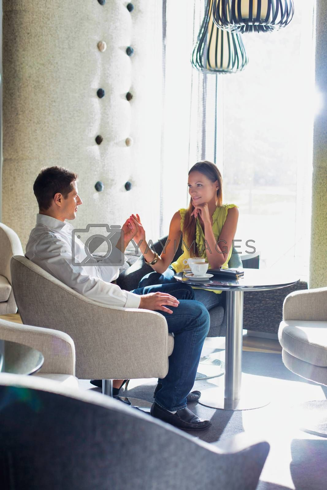 Couple on a date in a café or restaurant by moodboard