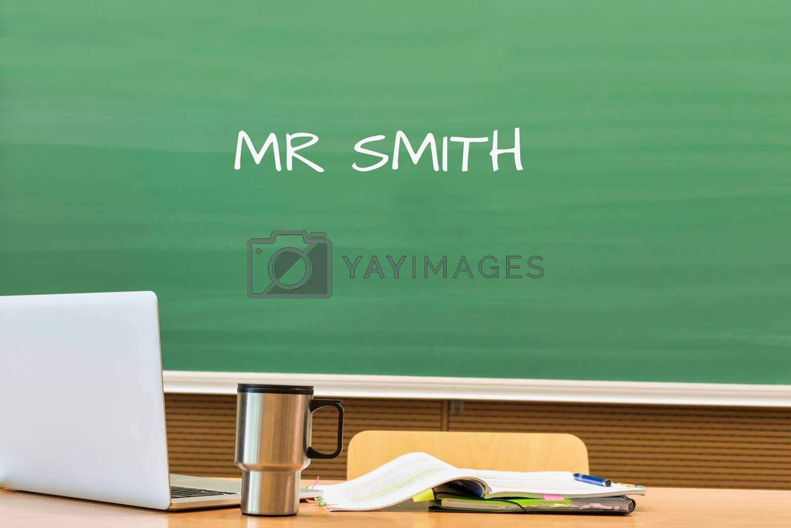 Photo of professor desk in classroom with Miss Simpson name written in black board