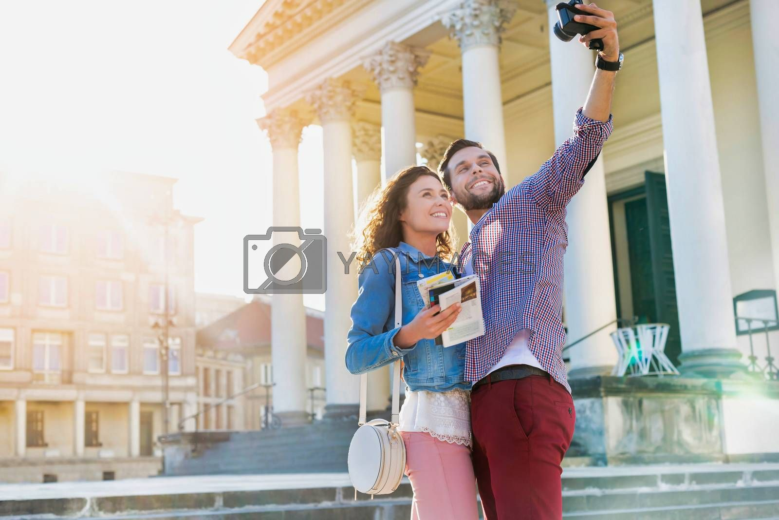 Portrait of young attractive couple taking selfie