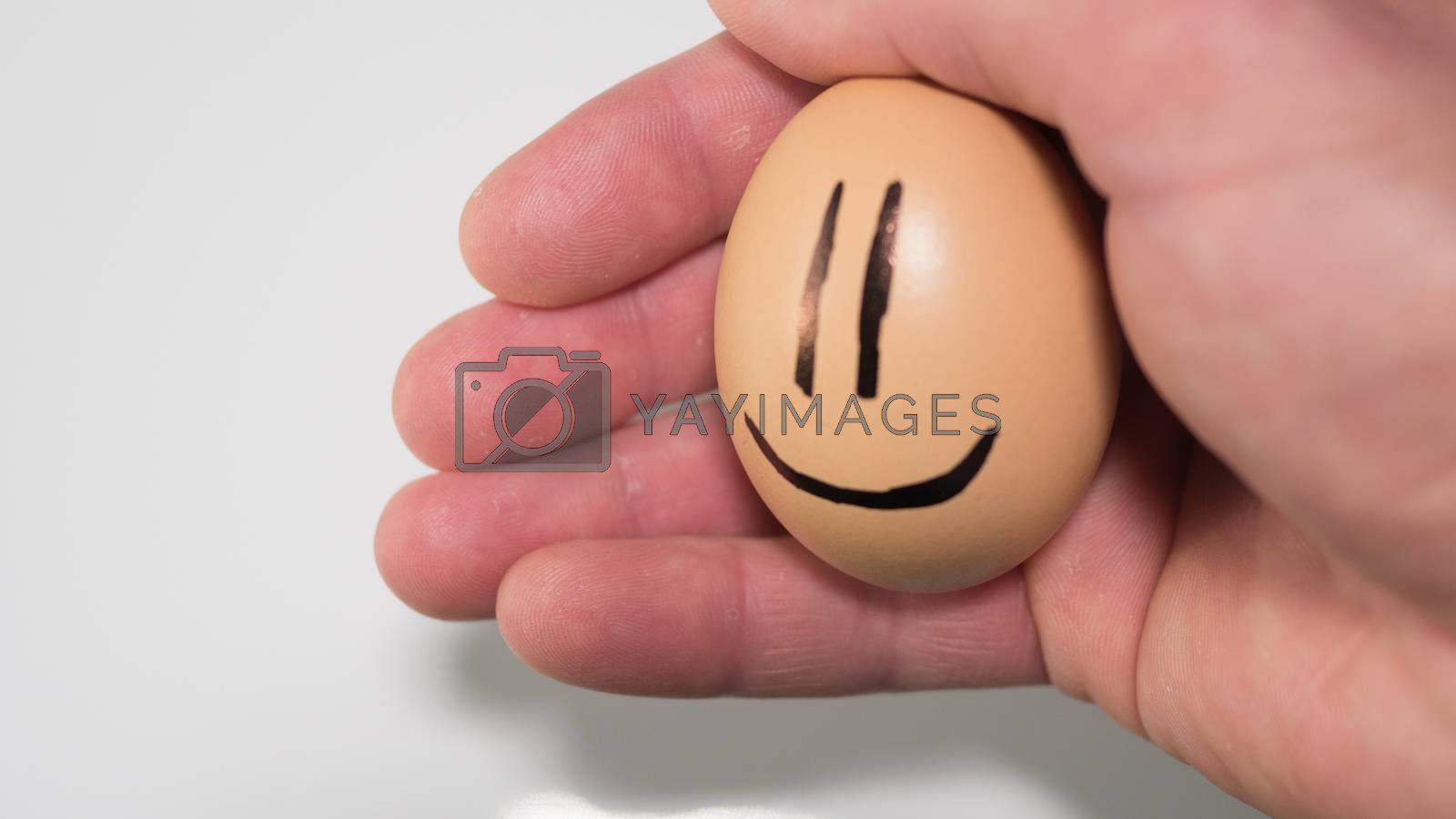 Egg with emotions, with a smile