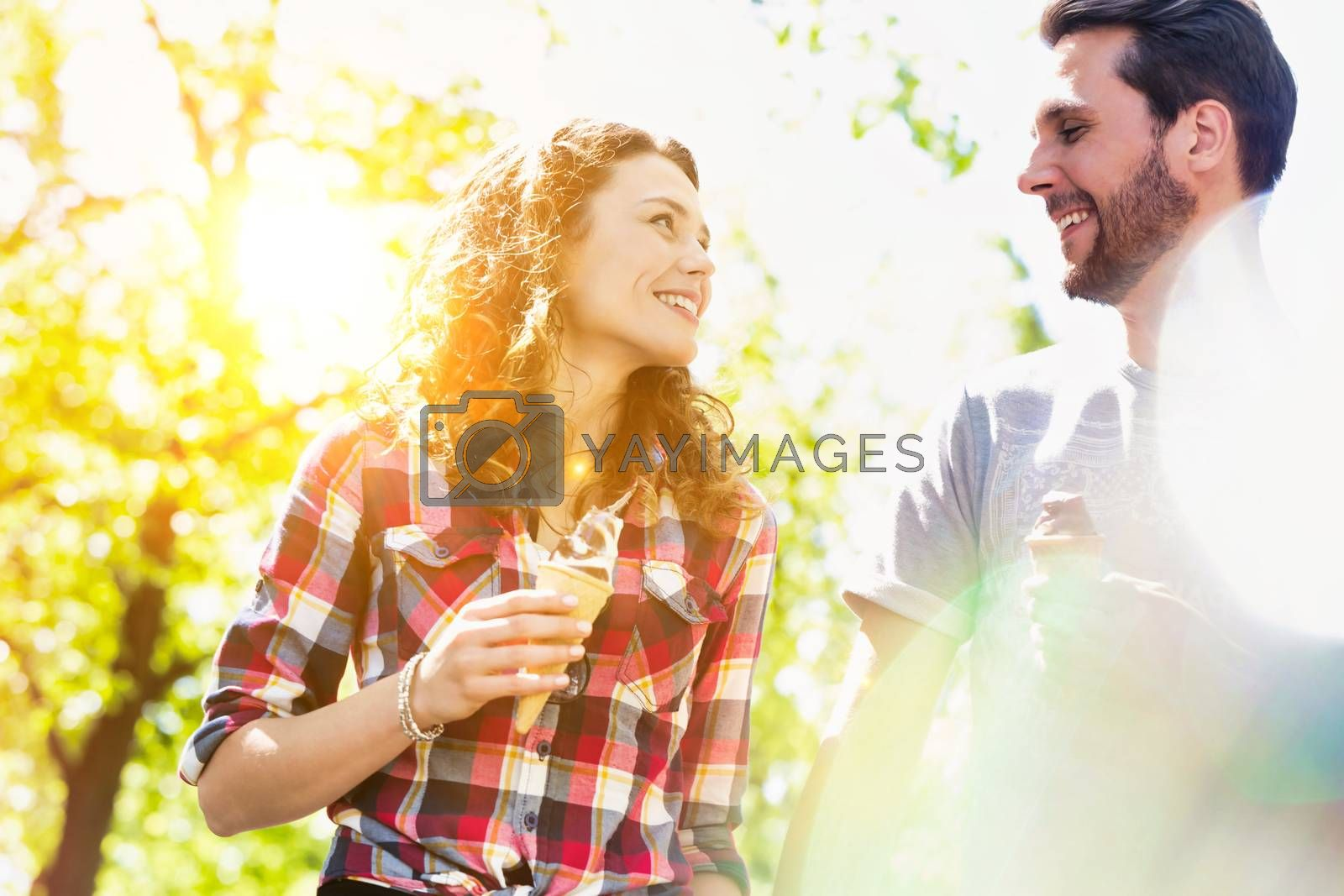 Portrait of young attractive couple eating ice cream by moodboard