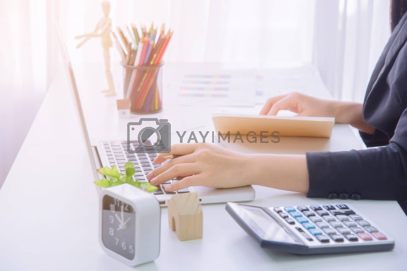 A young business woman using laptop computer on the table, Looking for direction and inspiration.