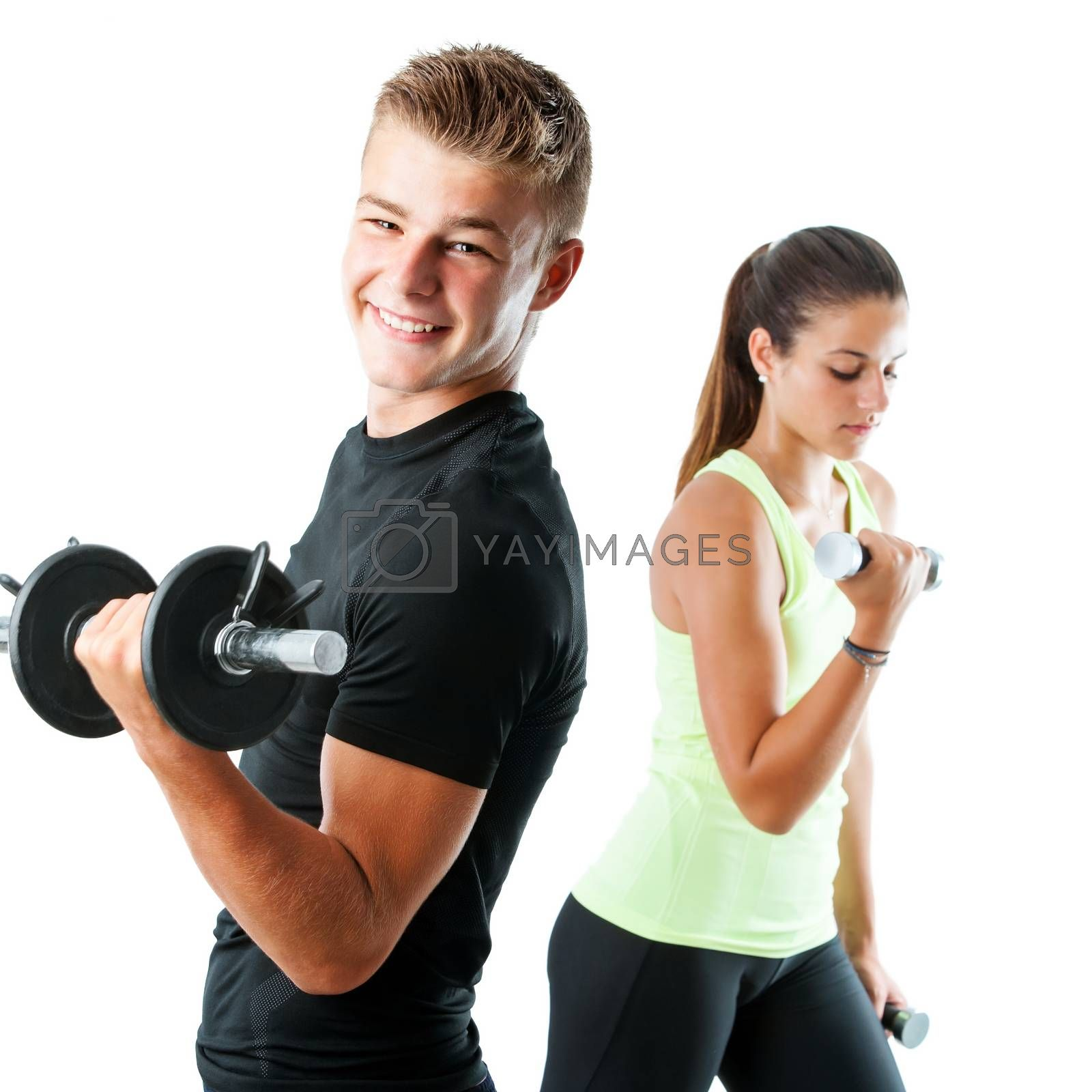 Close up portrait of handsome teen boy working out with weights.Out of focus girl working out in background.Isolated on white.