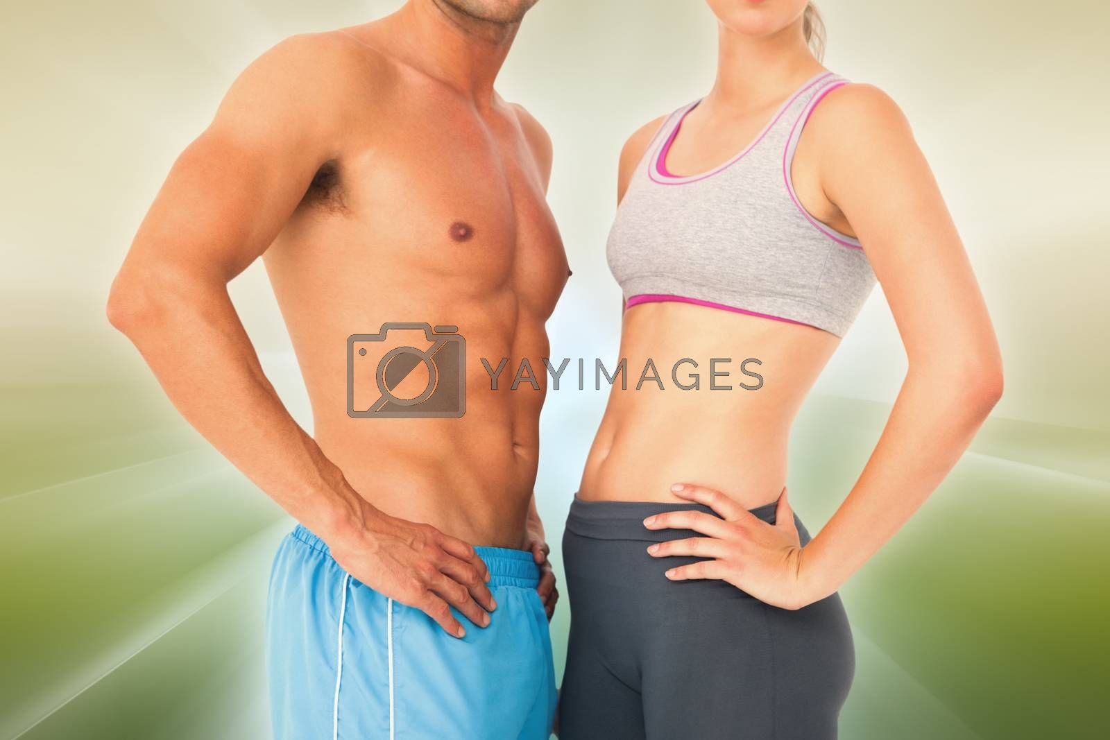 Mid section of a fit young couple against abstract background