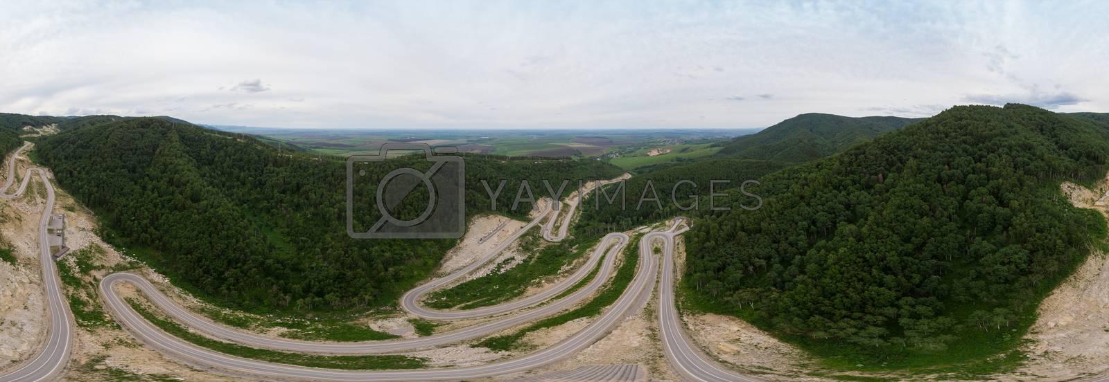 Full 360 equirectangular spherical panorama of aerial top vew of winding road in the mountains, drone shot. Altai Krai, Western Siberia, Russia. Road to Resort town Belokurikha 2. Virtual reality content