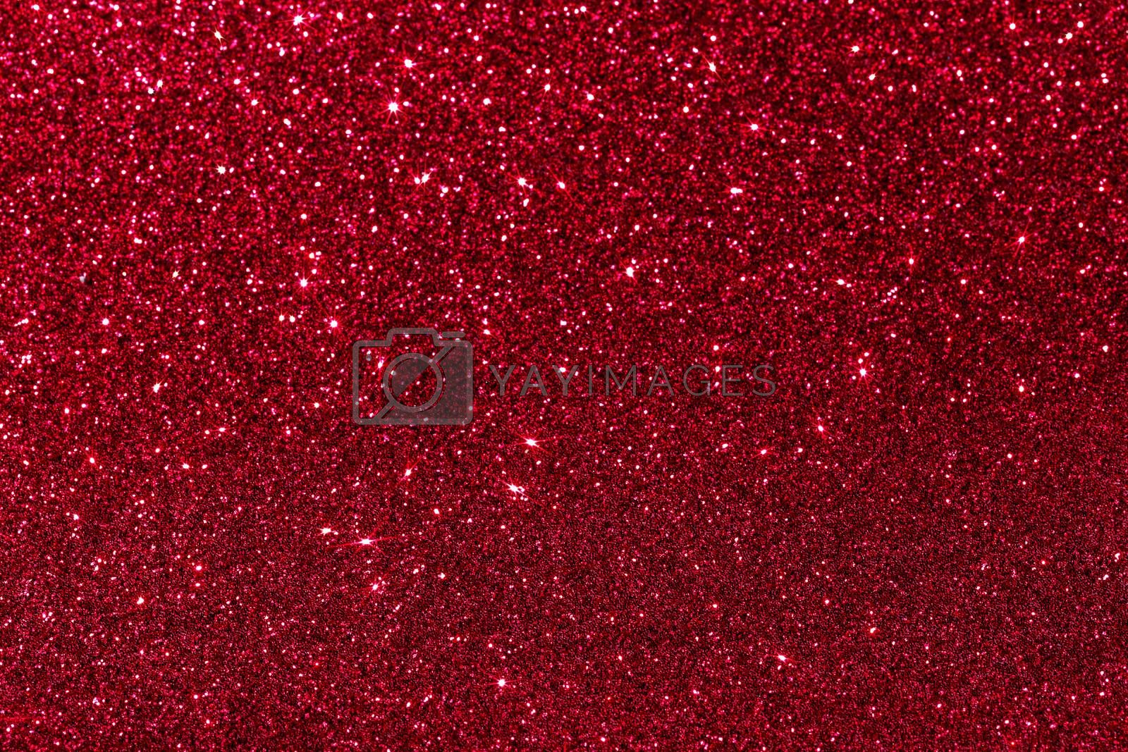 Red glitter texture holidays background. Macro shot