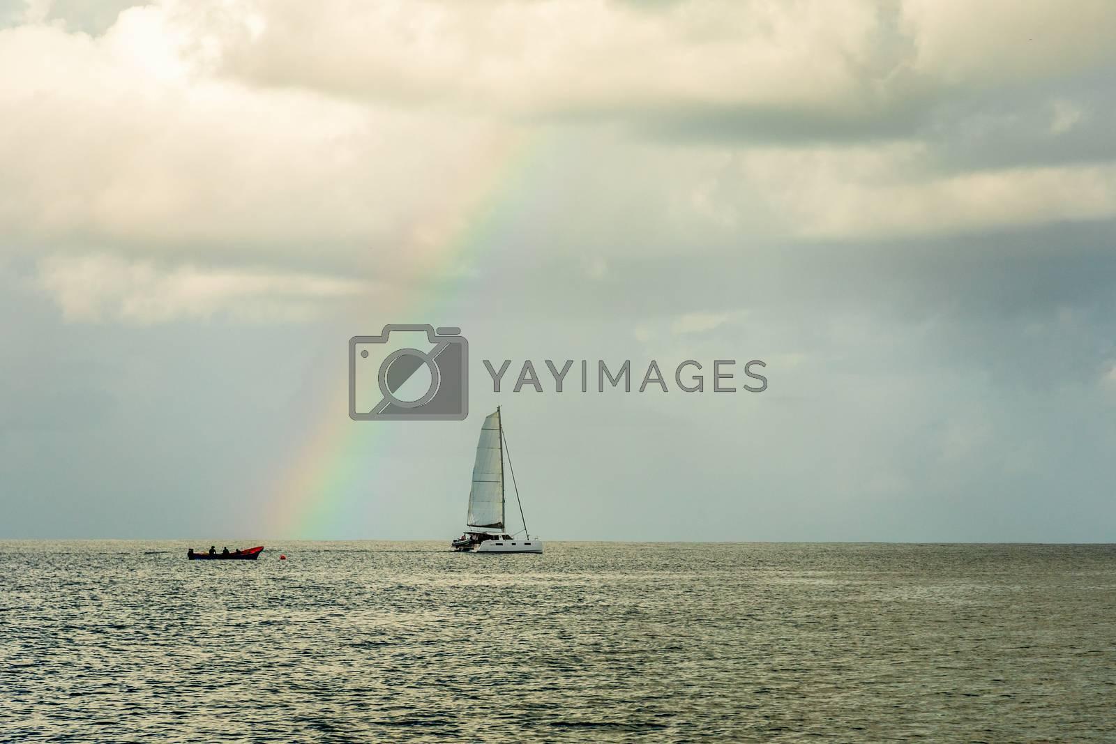 Catamaran at Rodney bay with rainbow in the backround, Saint Lucia, Caribbean sea