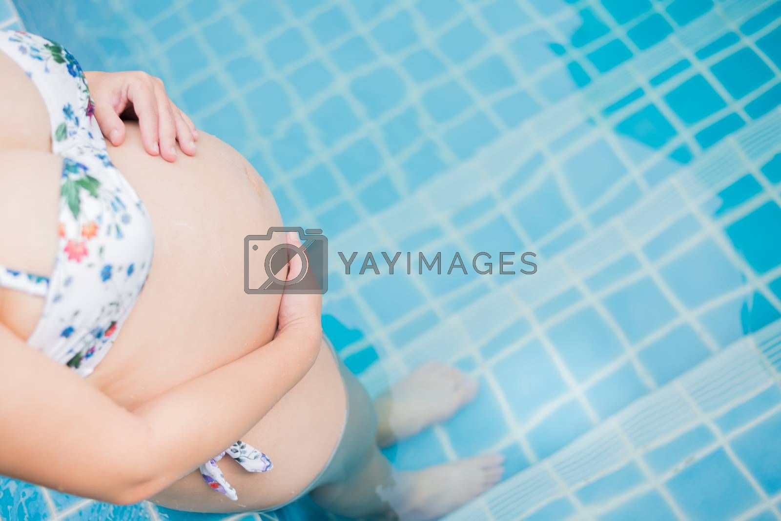 Asian pregnant woman. Mom and newborn baby. Mother day and International women day. Relax and recreation at swimming pool.