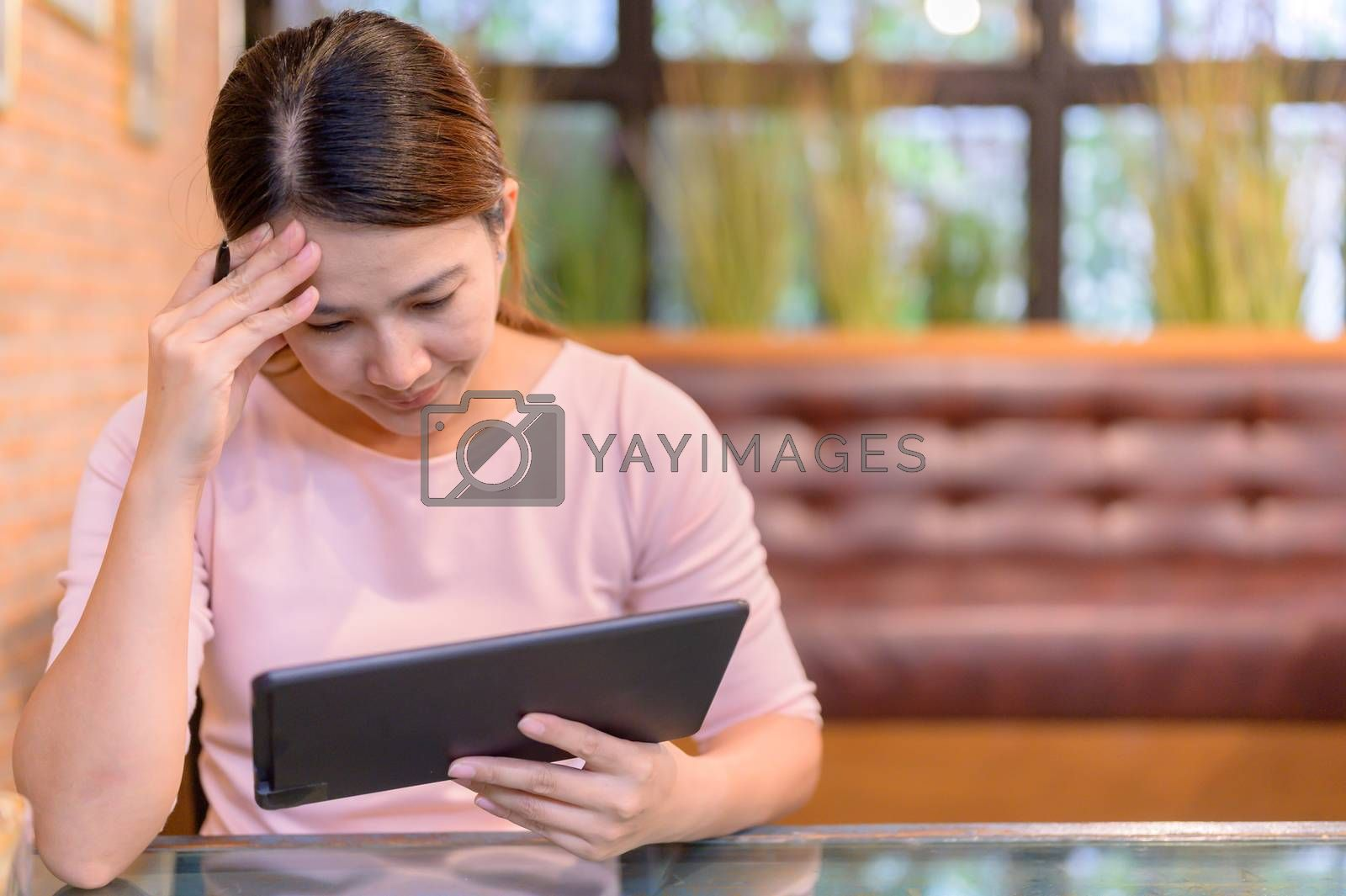 Unemployment and Mental health problem. Corona virus job losses in Asia. Thai businesswoman looking for new job on website. Post-traumatic stress disorder (PTSD).