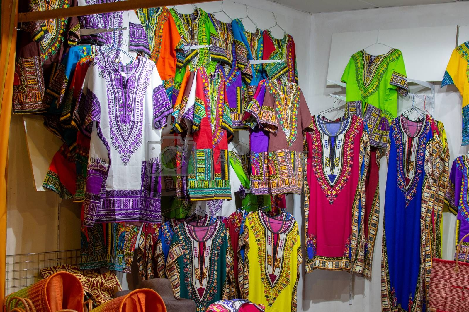"""""""Dubai, Dubai/United Arab Emirates - 4/6/2019: Beautiful African (Kenya and Tanzania) shirts or traditional colourful clothes handing for saleat Global Village creating a nice background."""""""