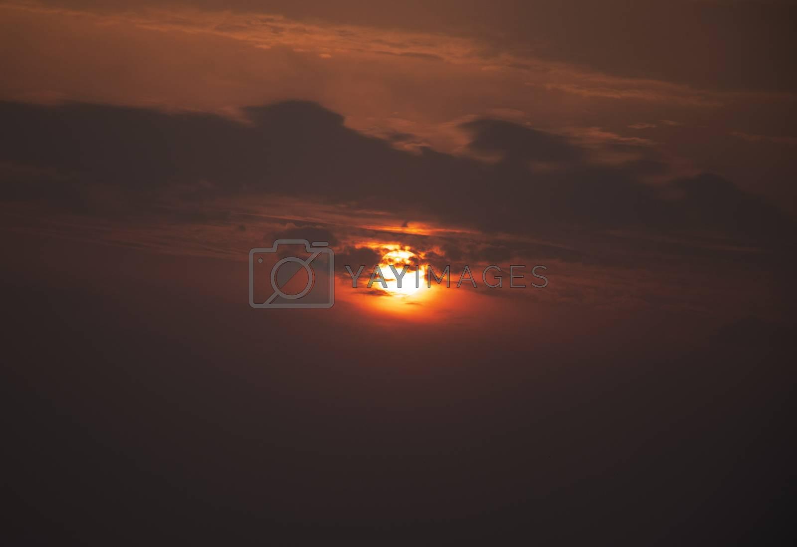 Cloudy sky golden sunlight, sun behind the clouds