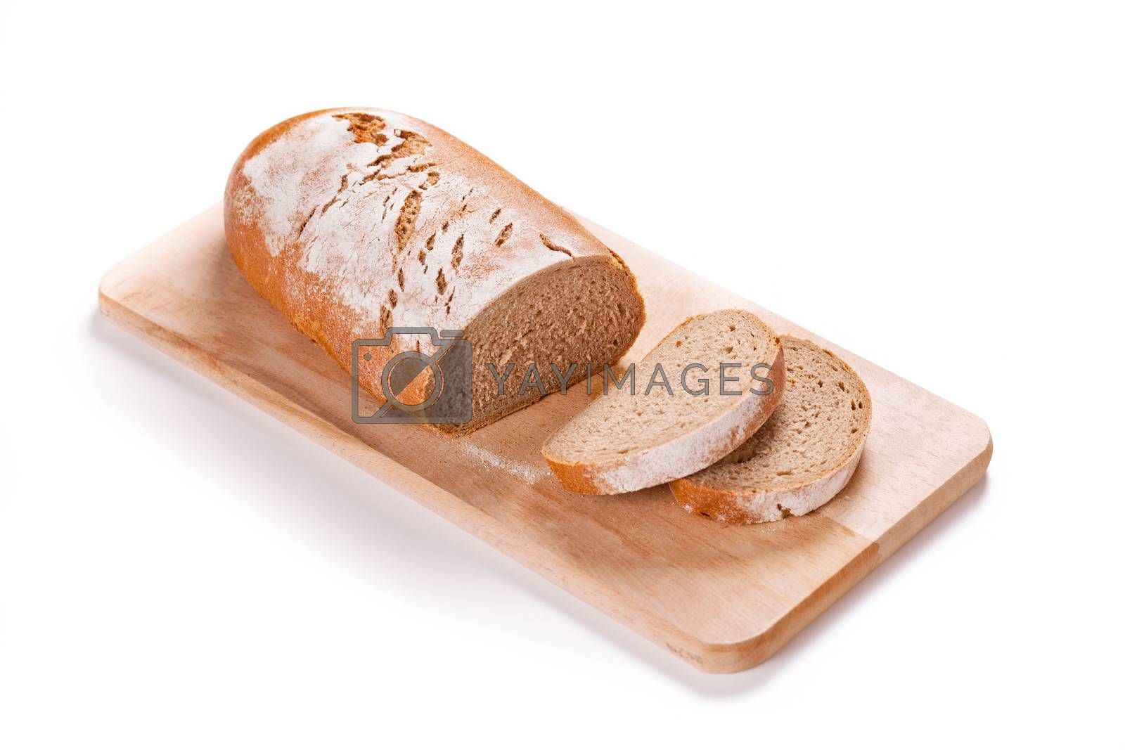 Loaf Of Bread On A Cutting Board Isolated On White