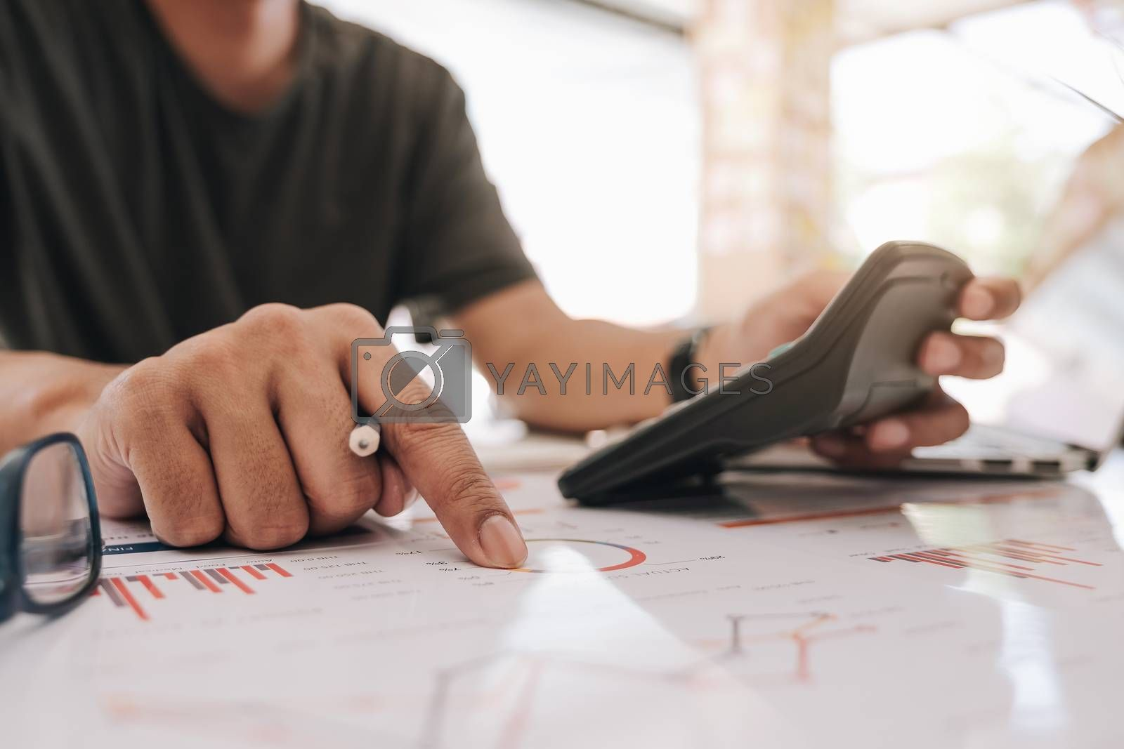 businessman working with calculator for financial document in office. male accountant doing accounting and calculating. bookkeeper making calculation. Savings, finance