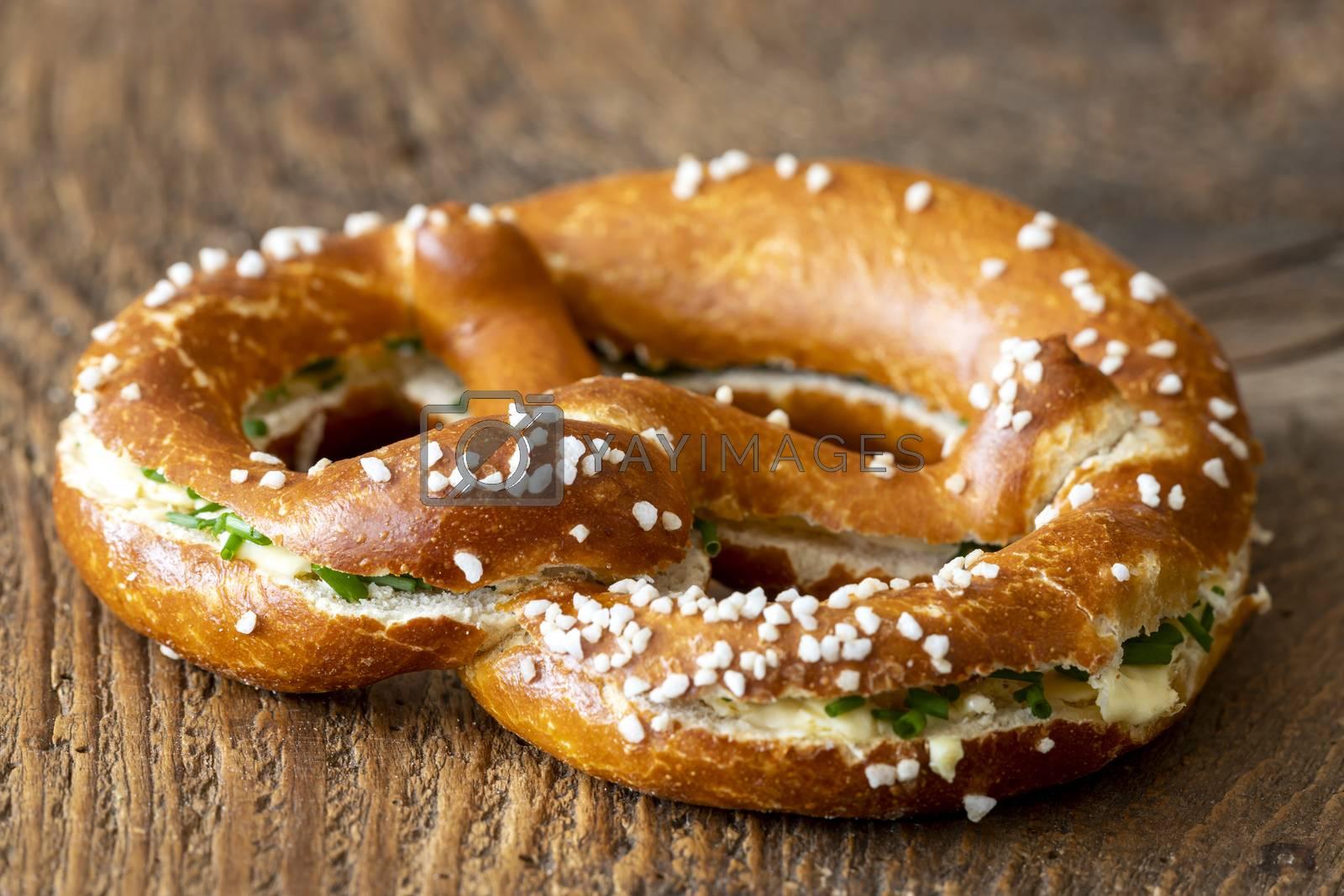 bavarian pretzel with butter on wood