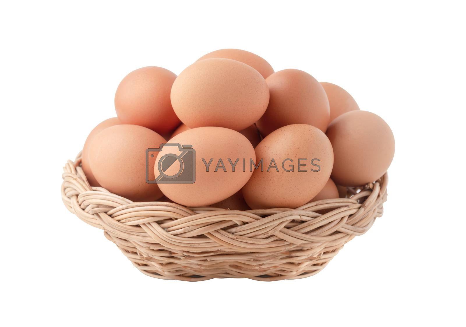 Raw eggs in the wicker basket isolated on the white backgrounds with clipping paths