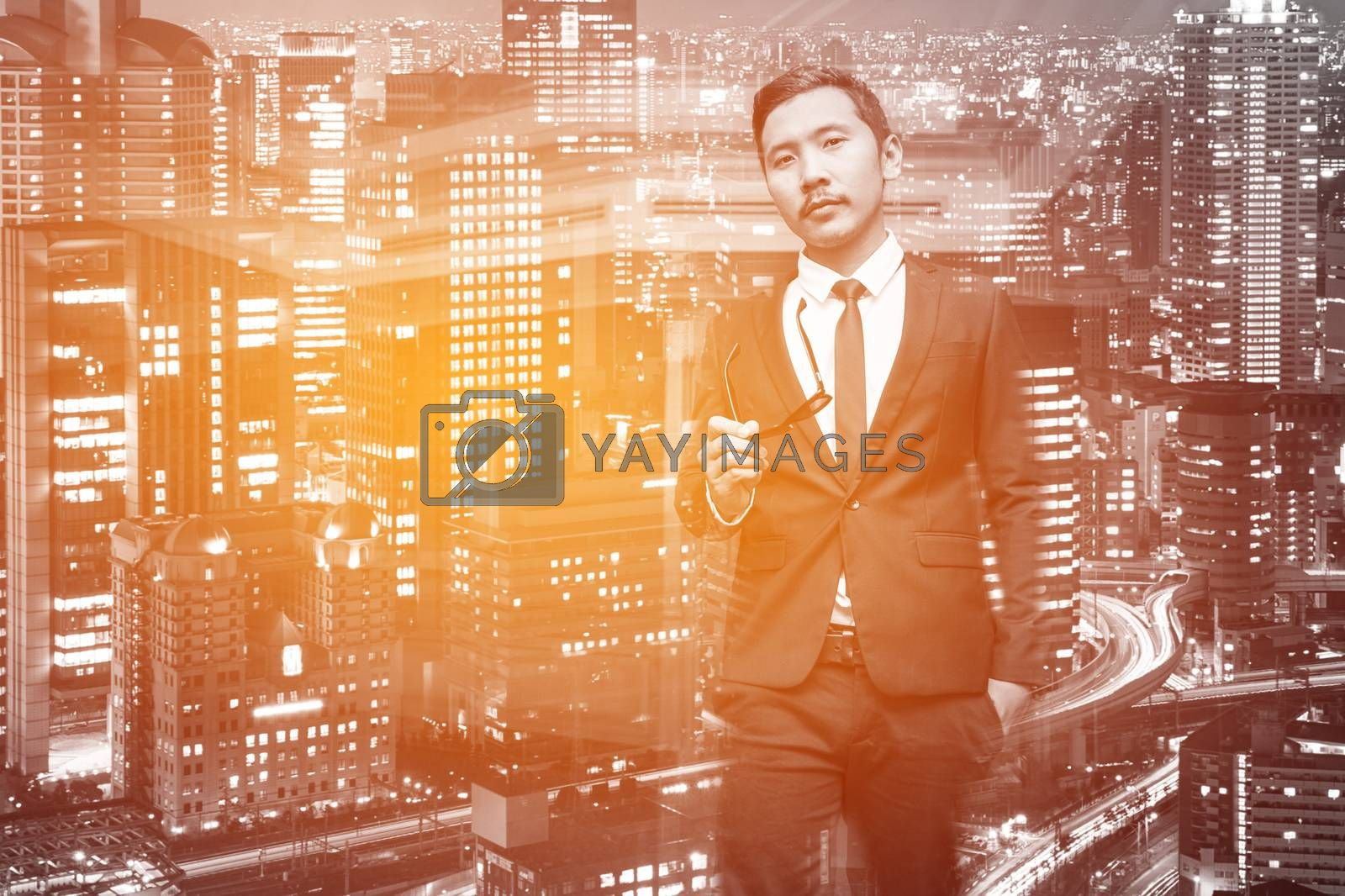 Young Asian Businessman in business background