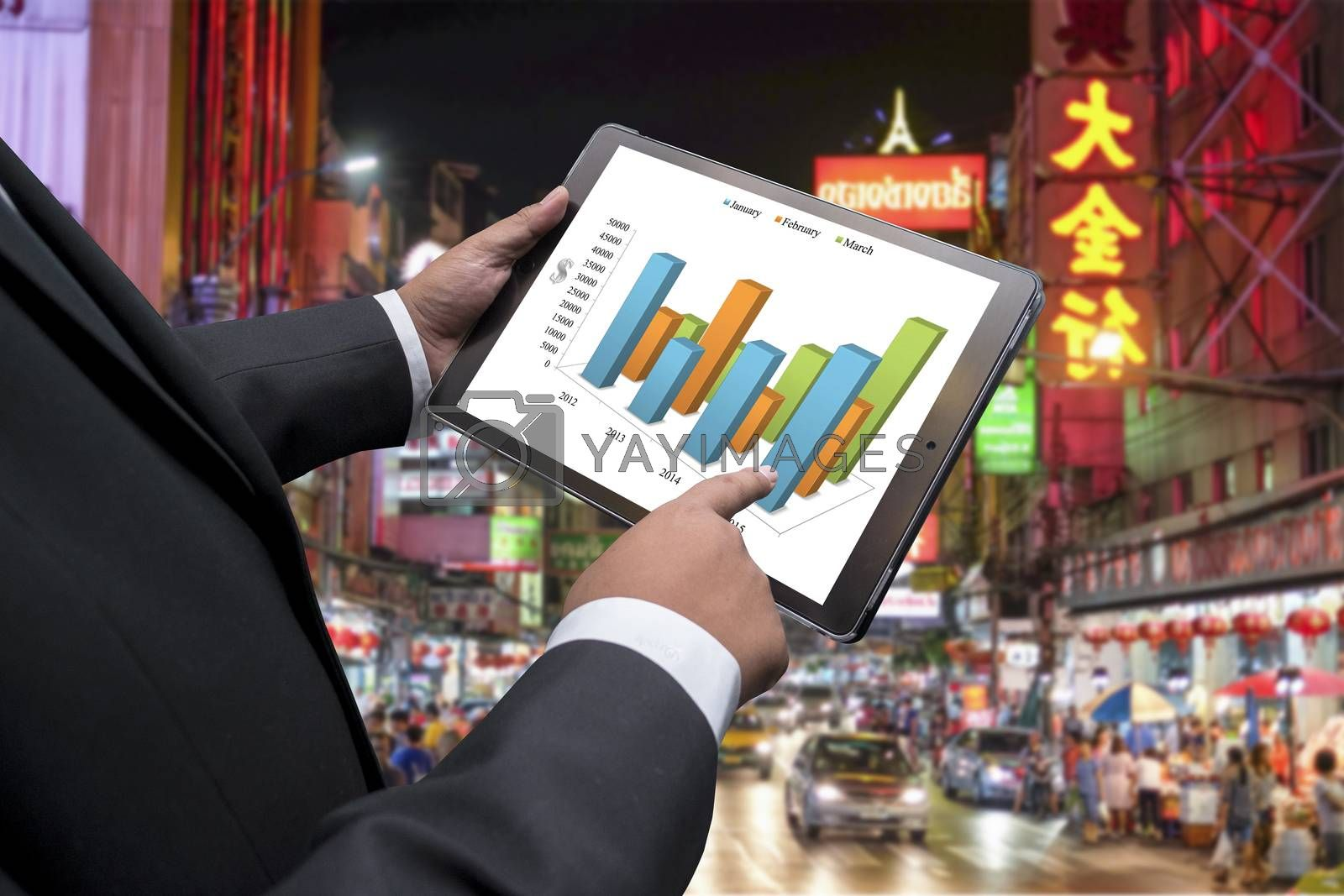 Business man doing business in china town on the screen of a touch-pad