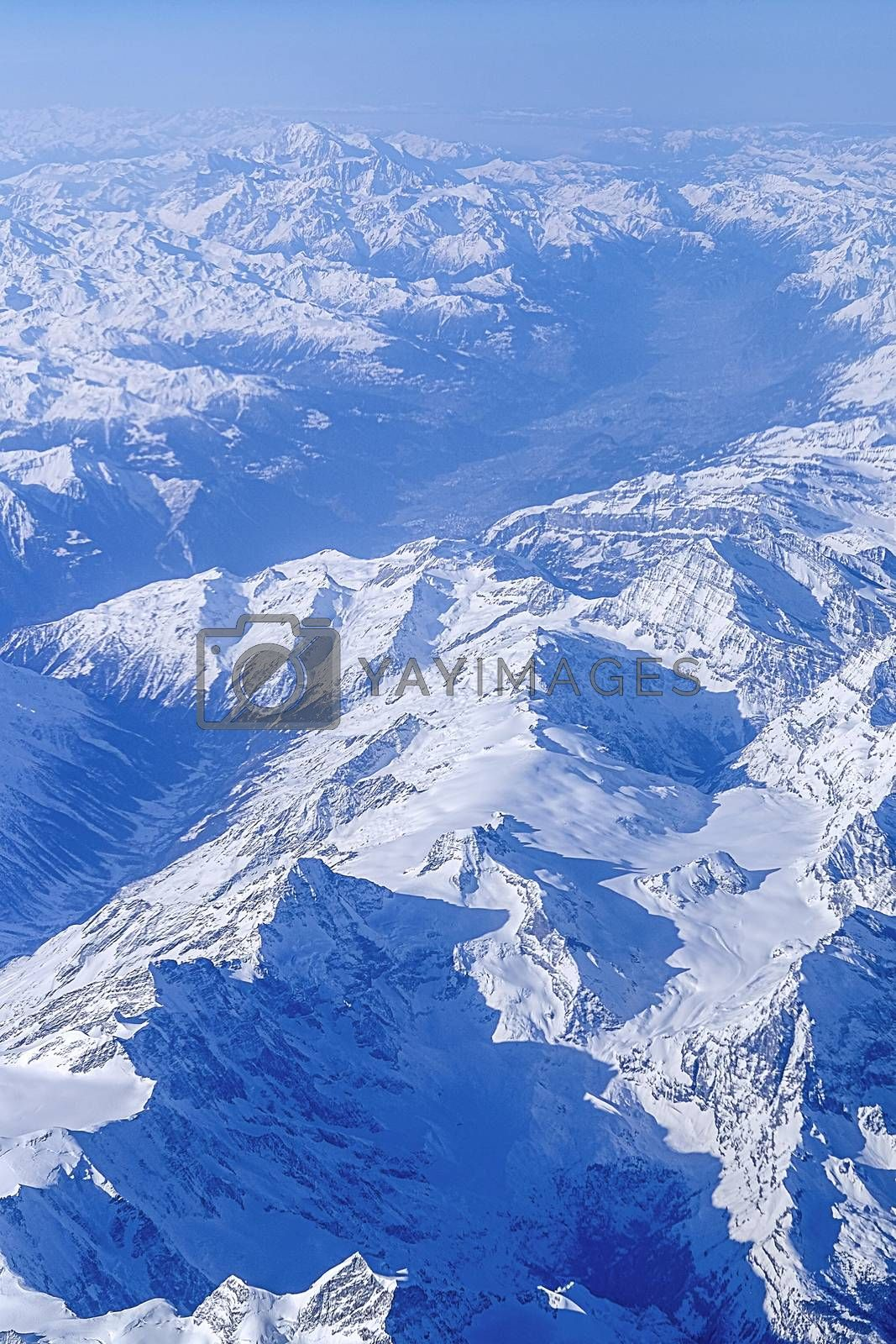 High mountains covered with snow   by Surasak