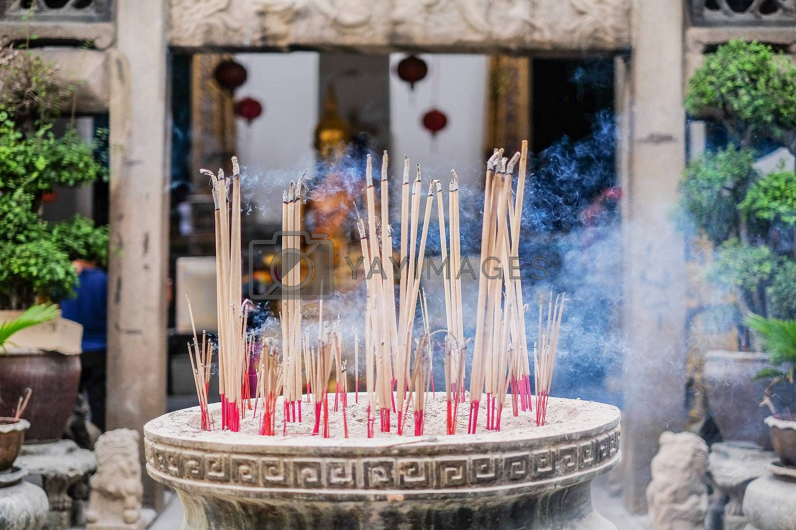 Incense sticks in ashes bucket in Temple Thialand  by Surasak