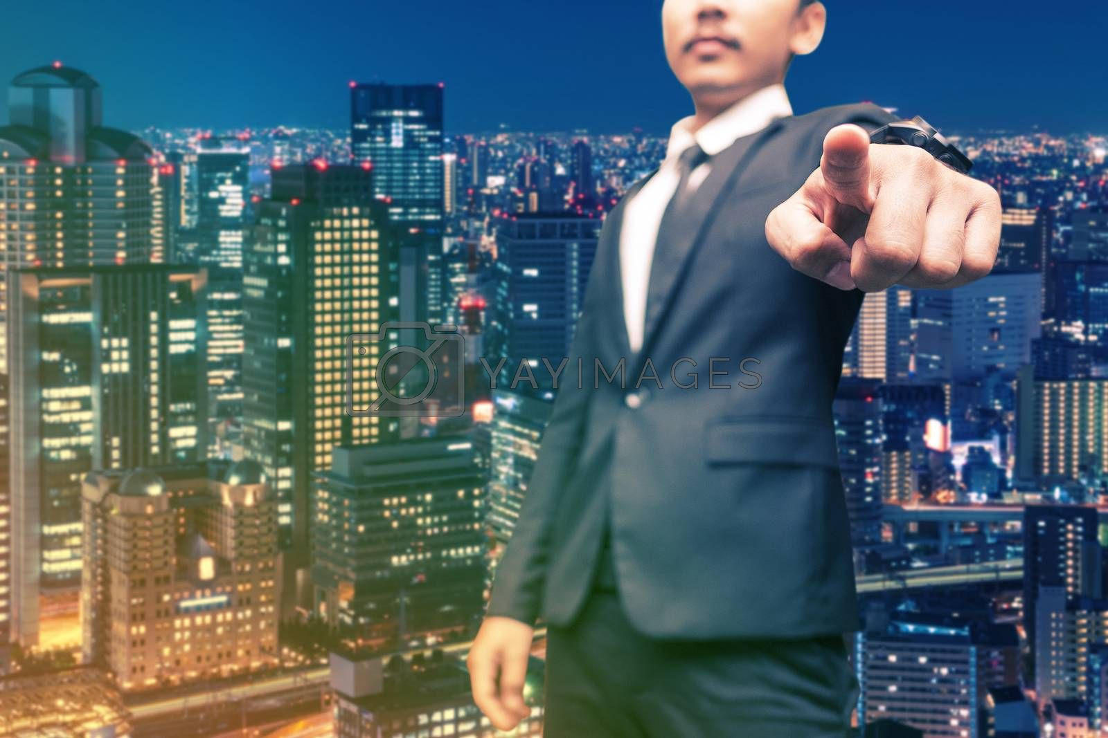man in suit on a building business wall background