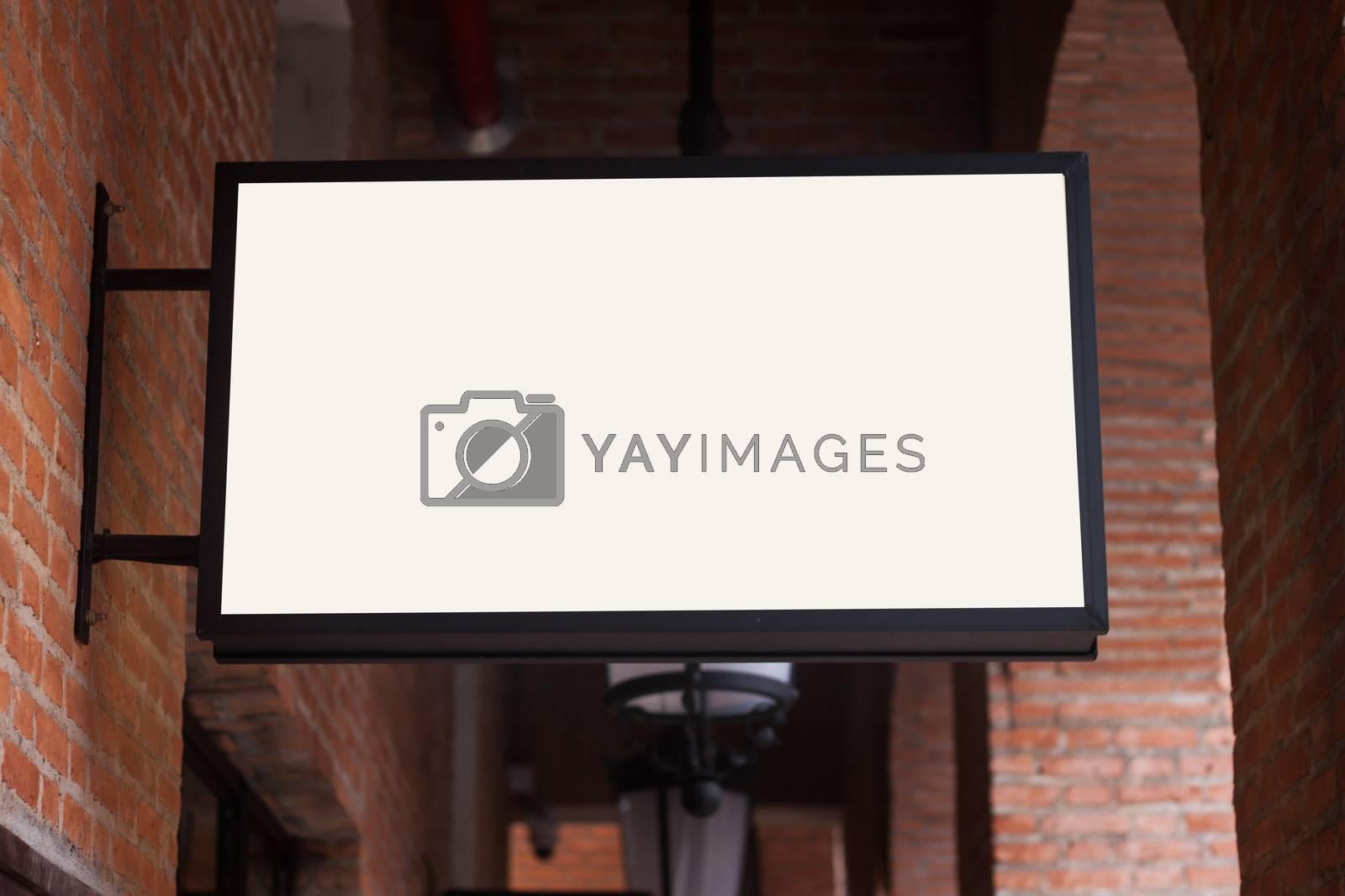 White regtangle signboard on the brick wall by punsayaporn