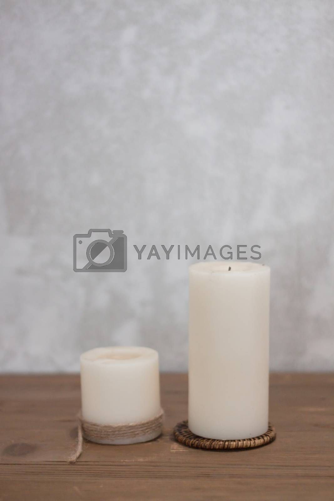 Two candles decorated in coffee shop by punsayaporn