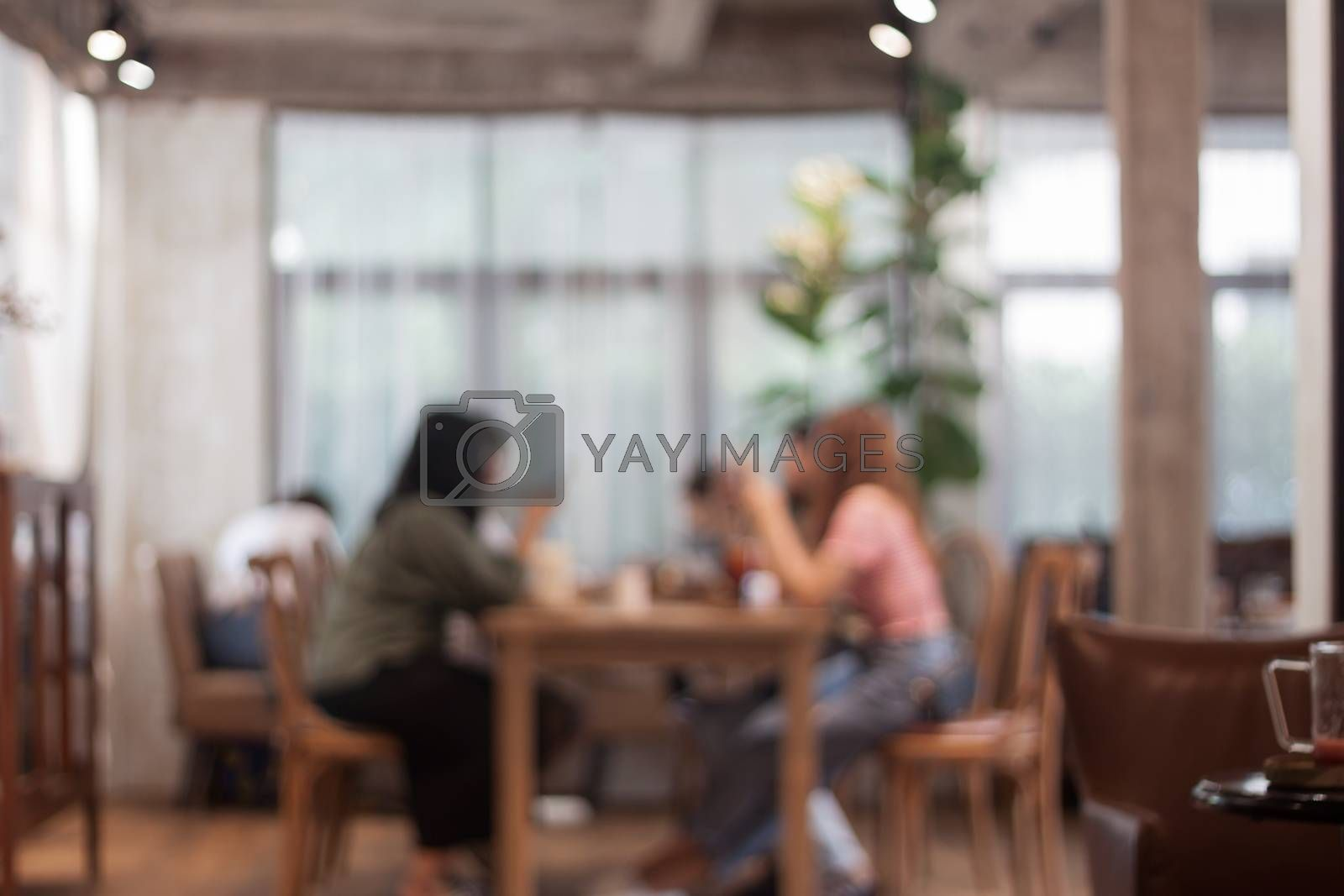 Blurred background of people in cafe, stock photo