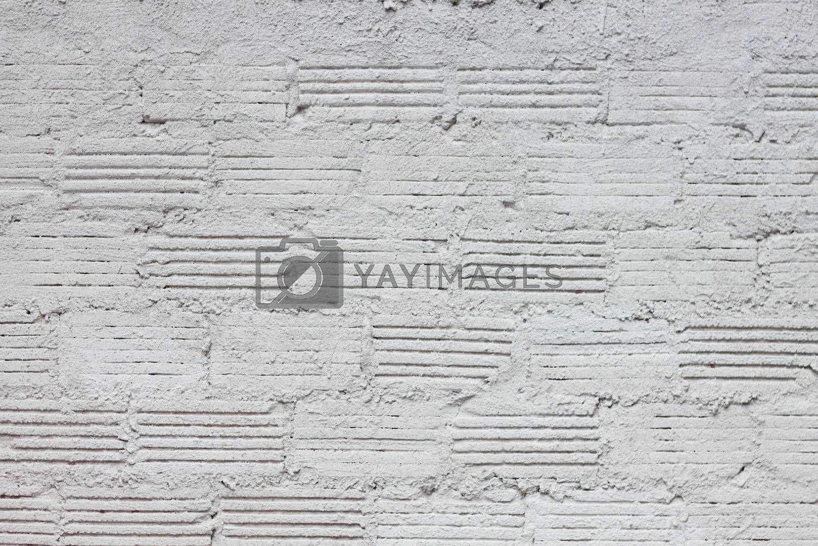 Abstract weathered textured white brick wall background, stock photo