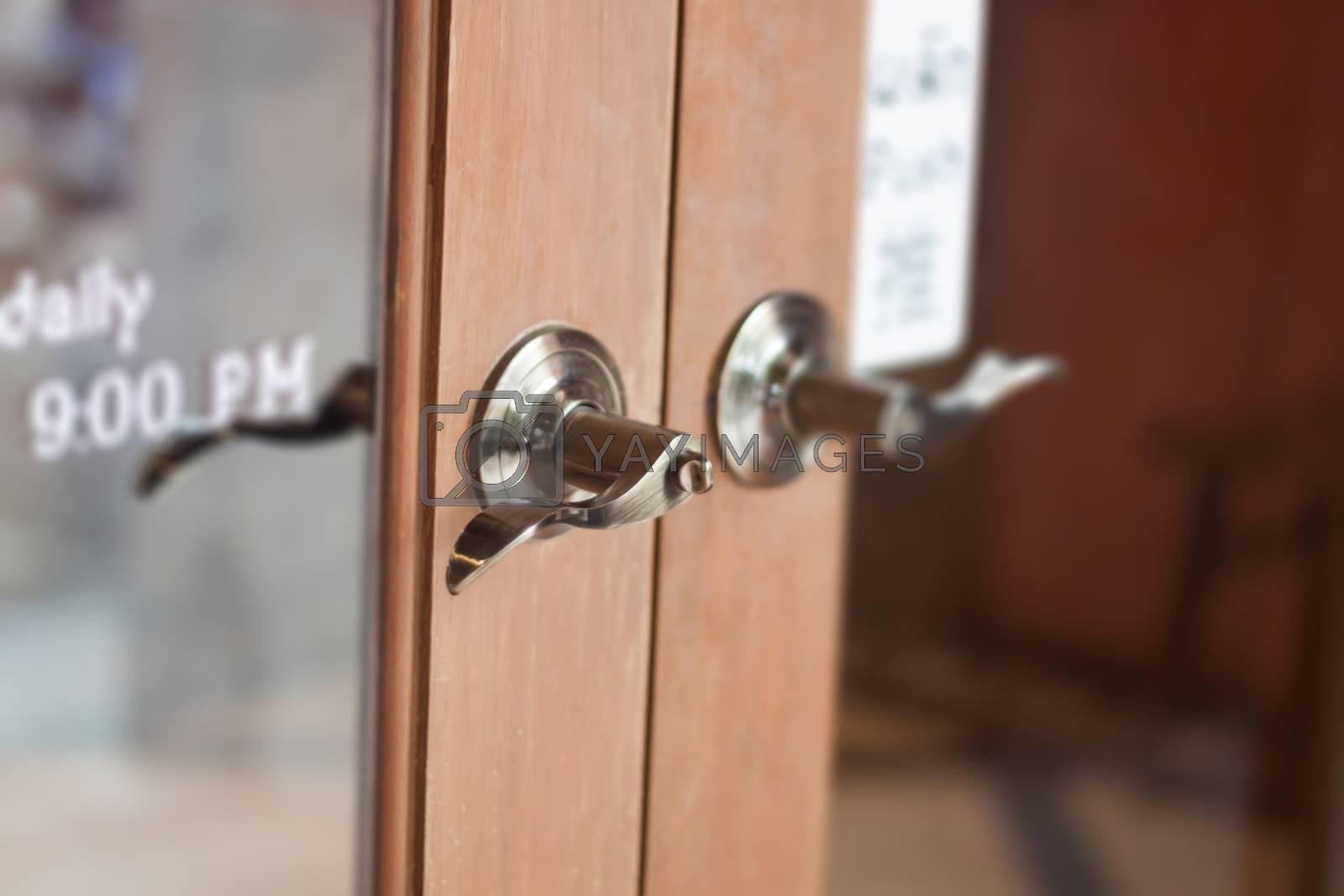 Metal door handles on wardrobe doors, stock photo