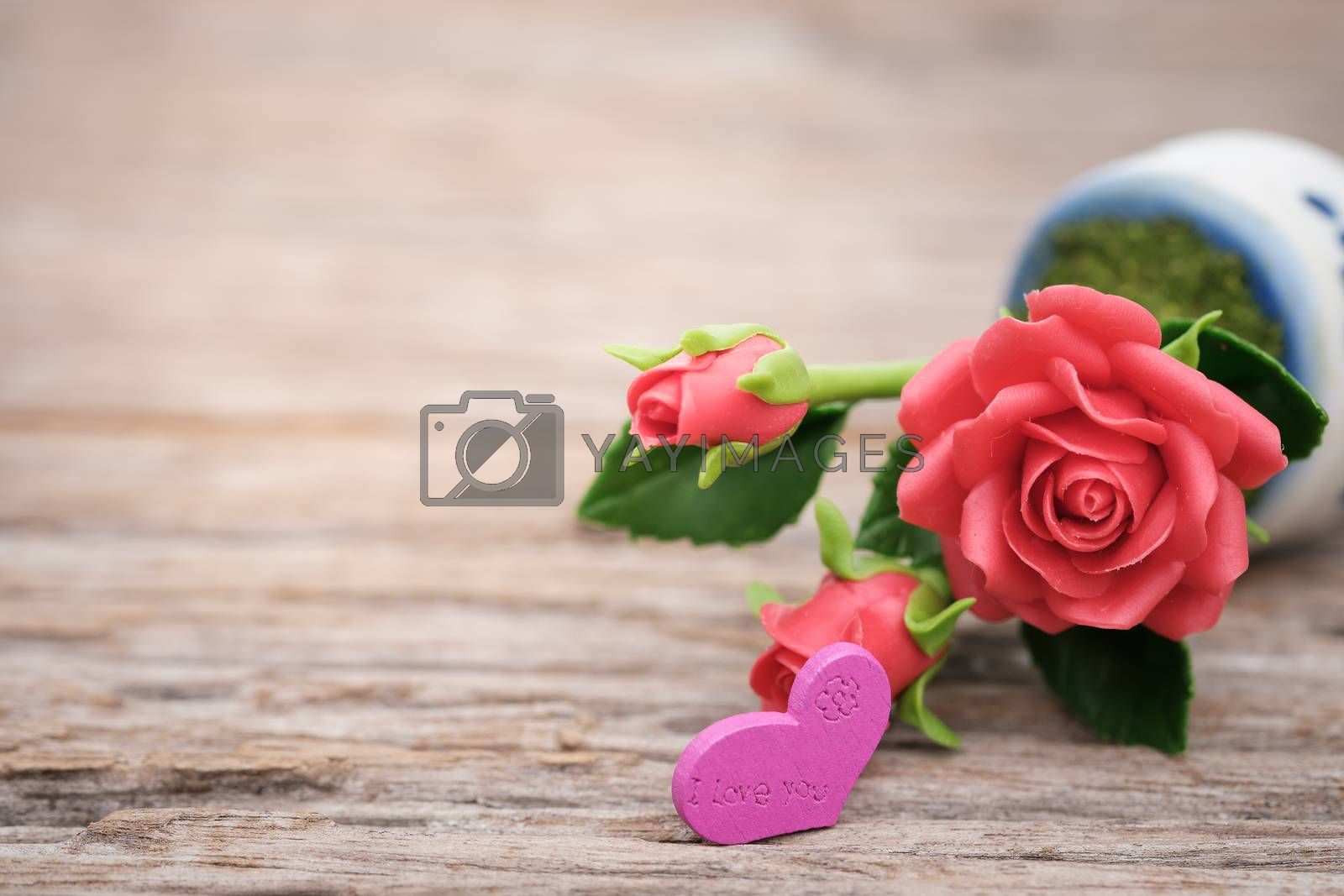 Heart shape and rose on wooden background with space to write. Valentine concept, Vintage tone, AF point selection.