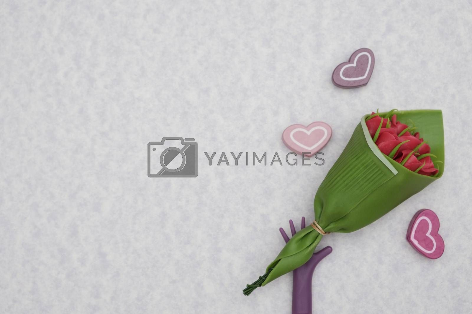 Hand holding a bouquet of flowers, Valentine concept.
