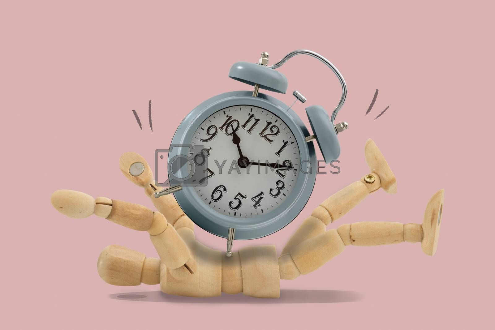 Clocks on the wooden puppet Isolated on pink background, Show your work until you have no time untill stress, Idea and concept of time picture.