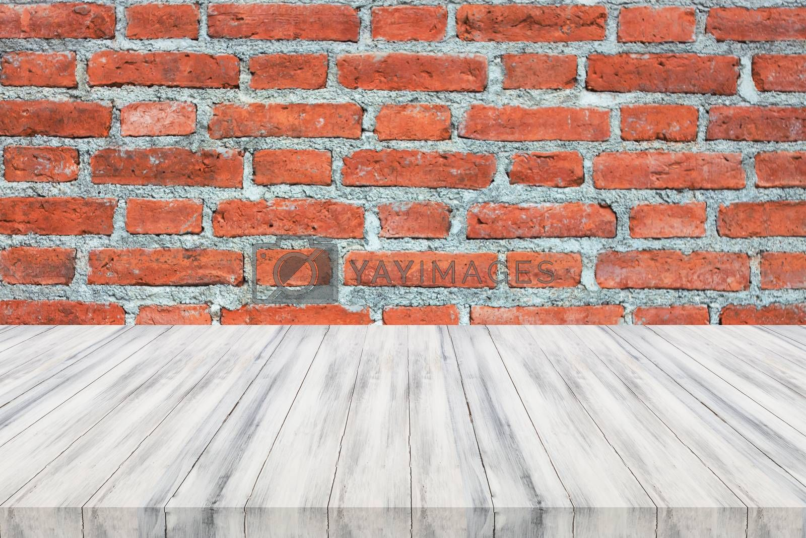 White wooden table top on brick wall. For product display