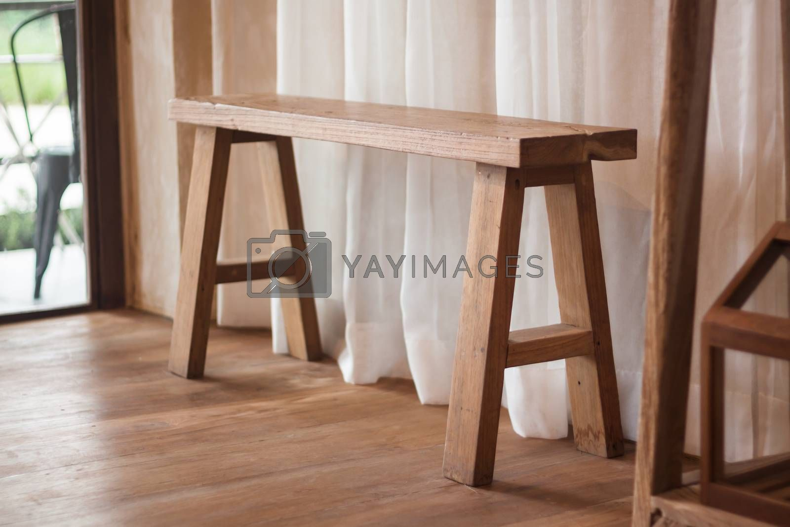Wooden bench cedorated in house, stock photo