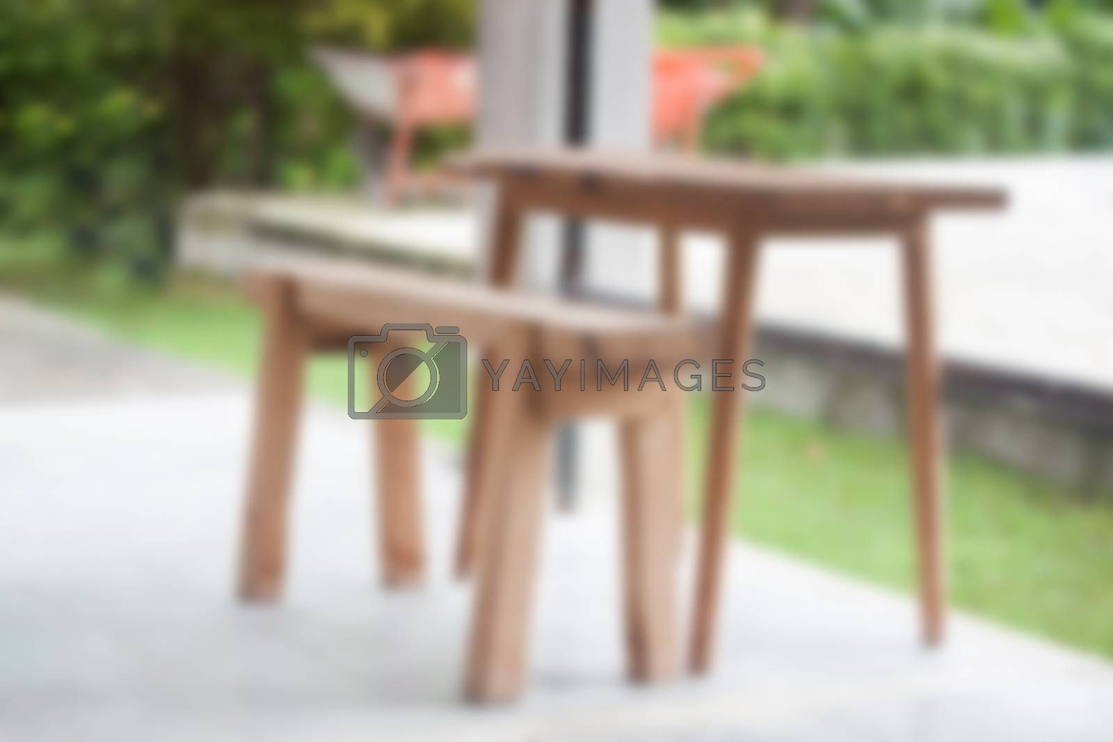 Wooden bench in the park by punsayaporn