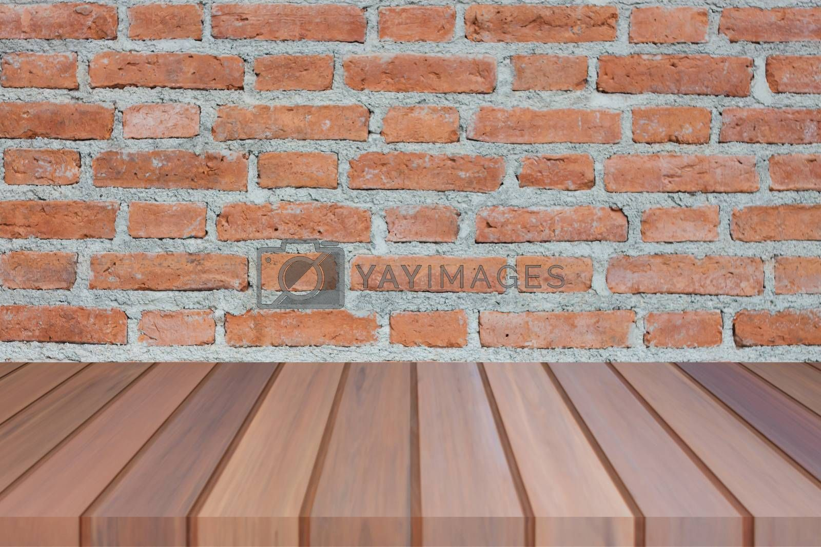 Brown wooden table top on brick wall. For product display