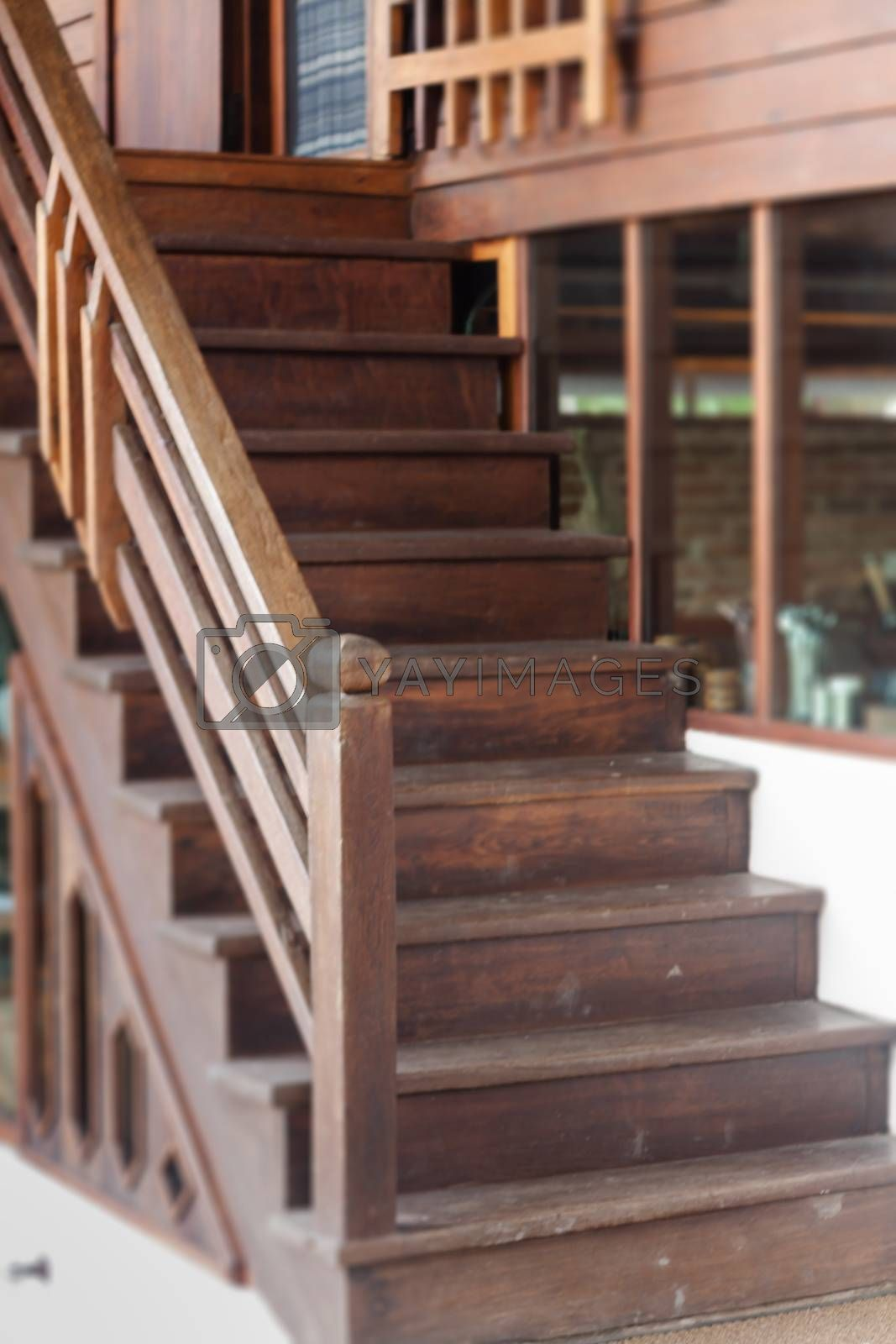 Wooden stairs in wooden house, stock photo