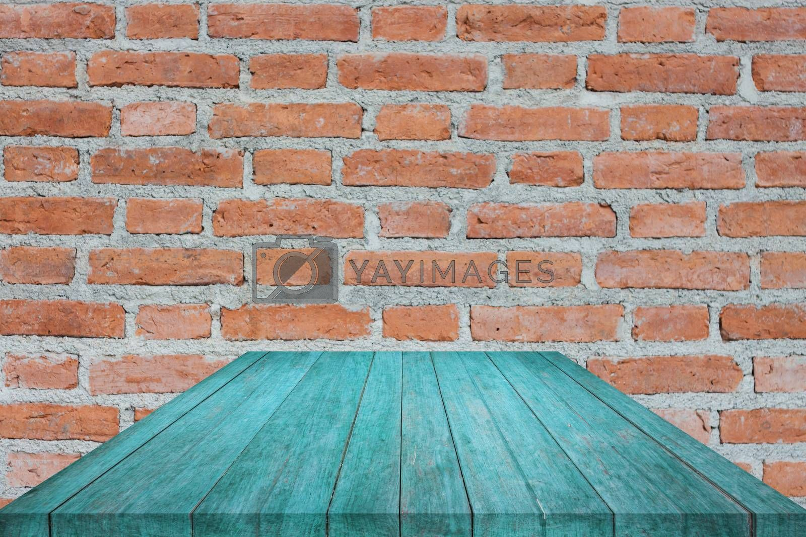 Perspective blue top wooden on brick wall, stock photo