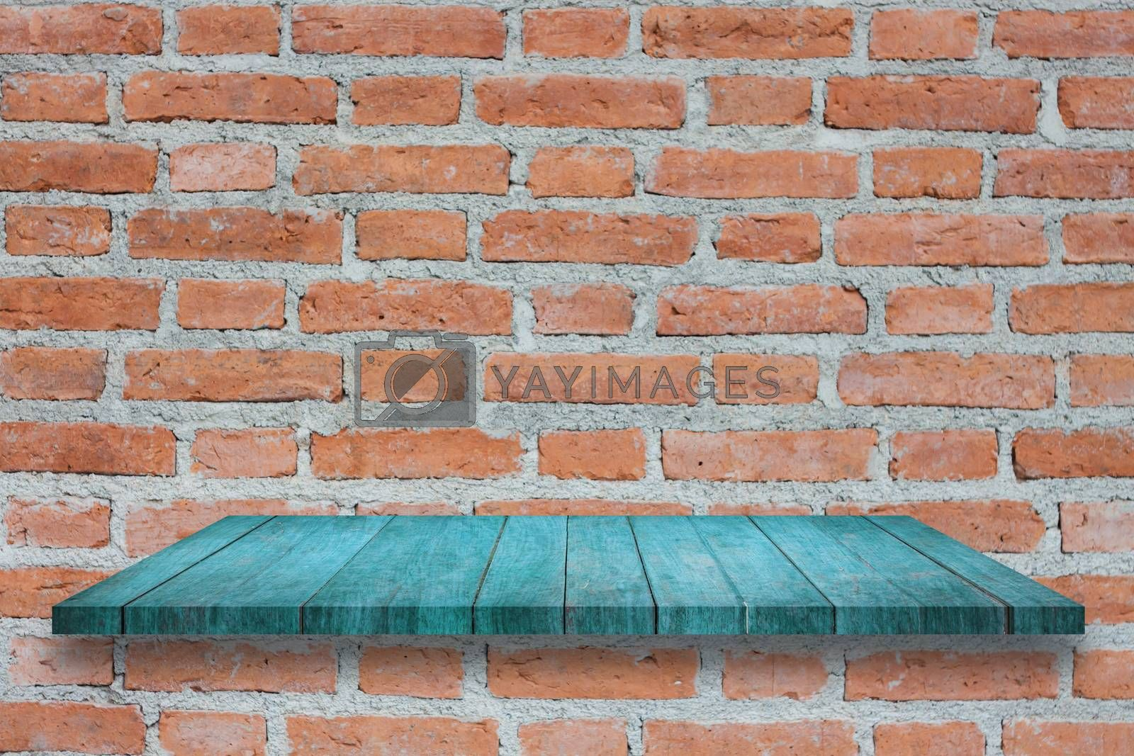 Top of blue wooden shelf on brick wall. For product display