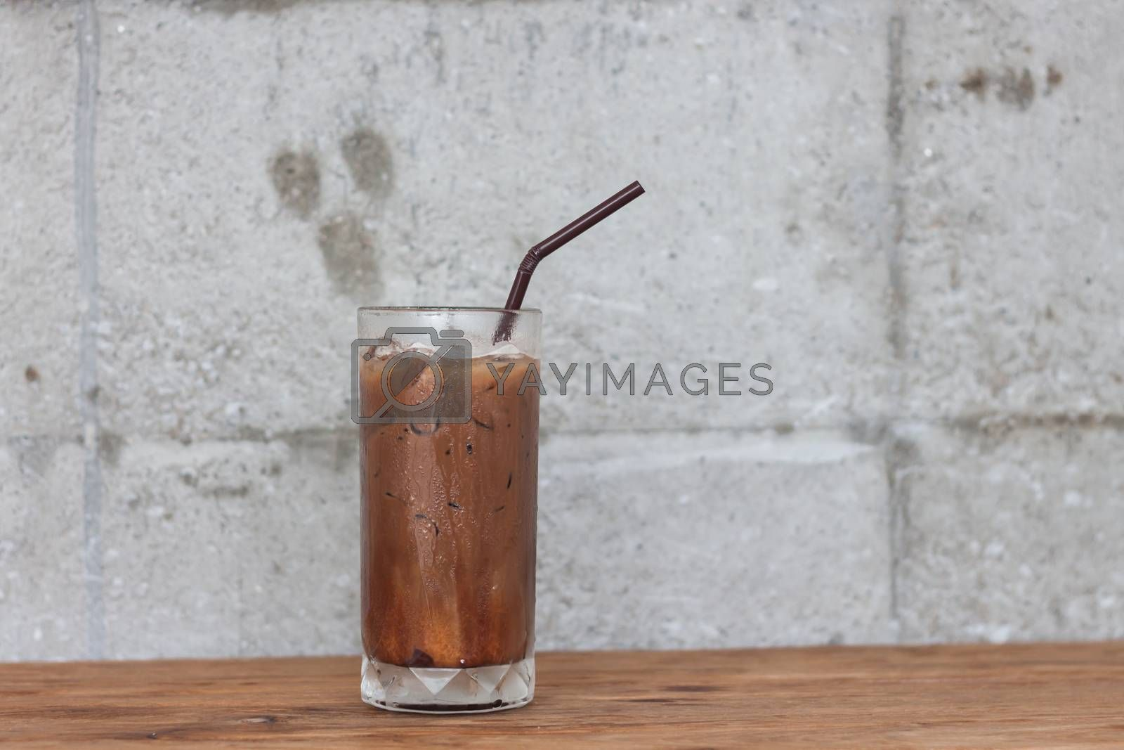 Ice coffee on wooden table, stock photo