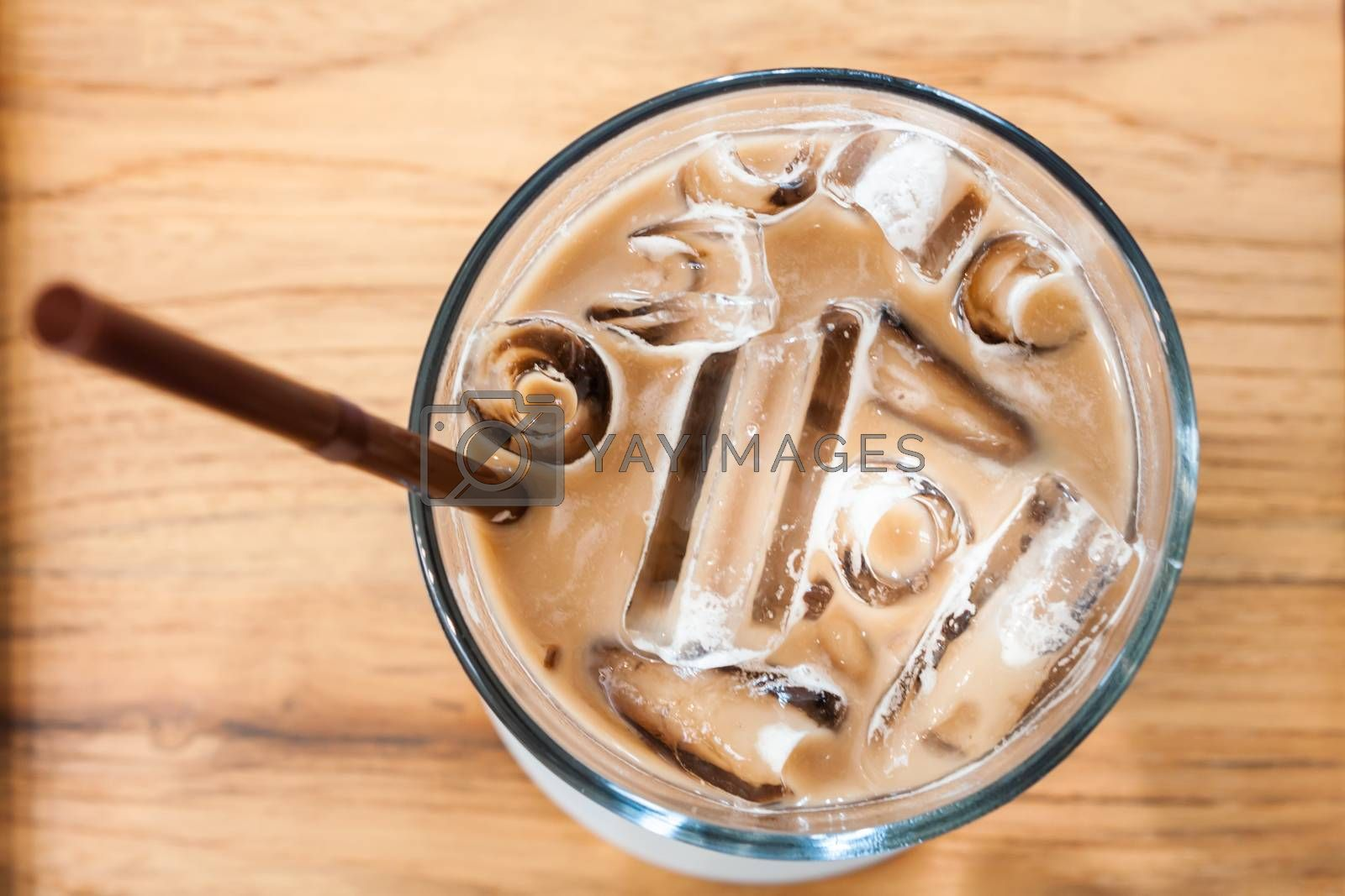 Iced coffee in coffee shop on wooden table, stock photo