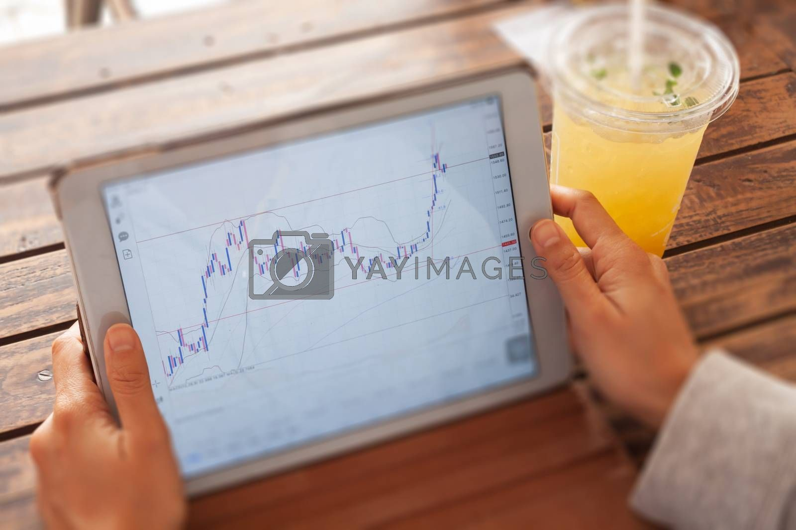 Woman hand trading online on tablet, stock photo