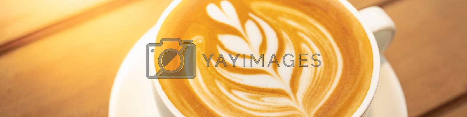 Closeup food and drink of hot coffee latte on dark wooden table with copy space using as background food cover page, coffee day concept.