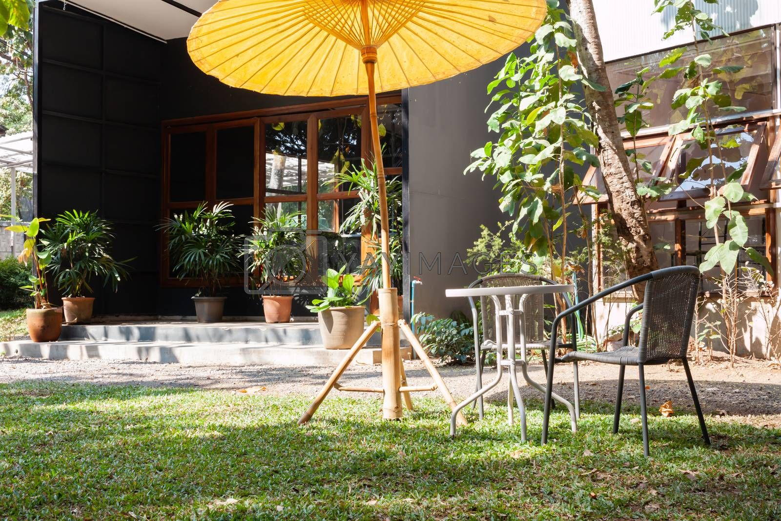Garden decorated in coffee shop by punsayaporn