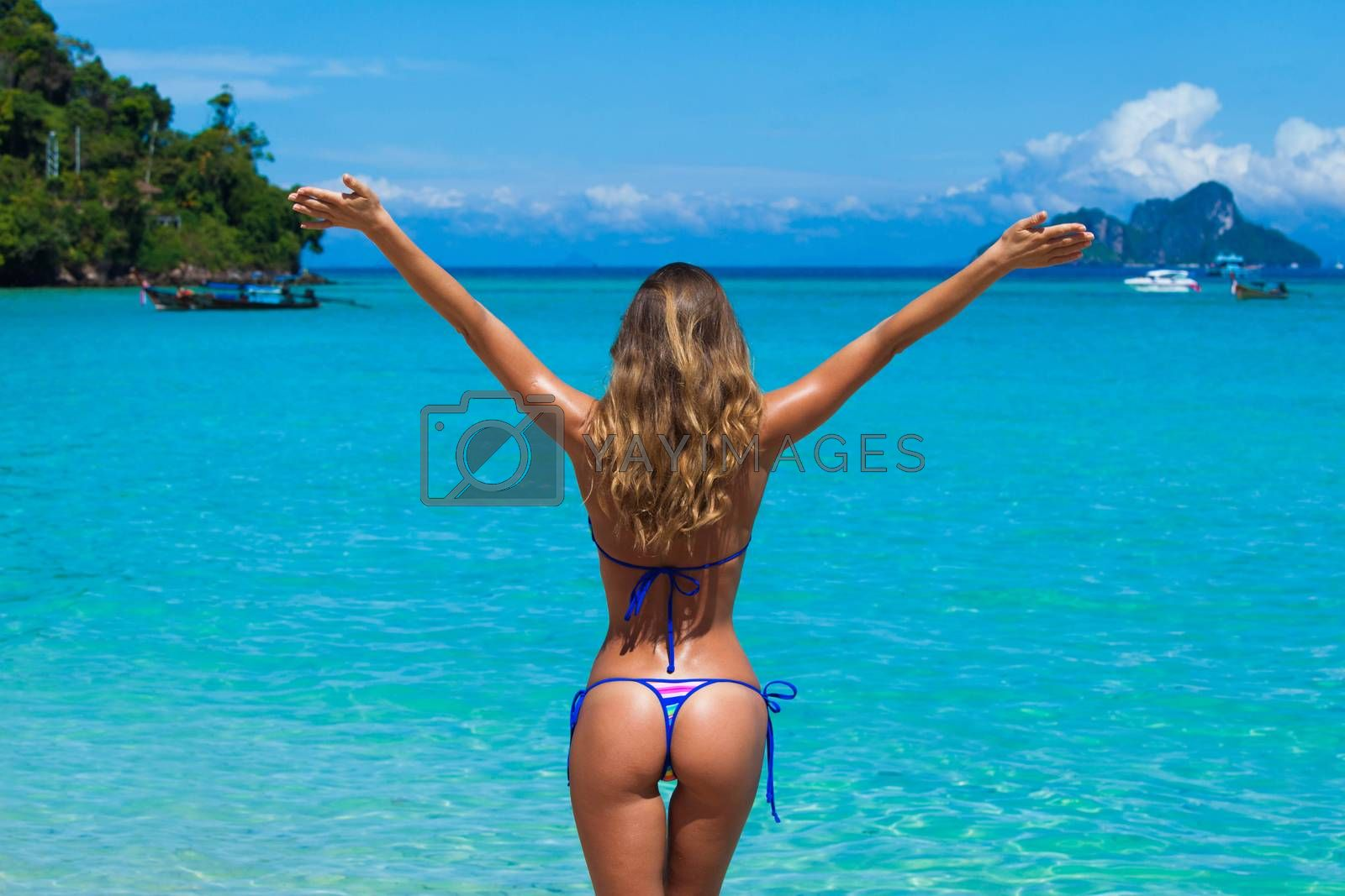Beach summer holidays woman in happy freedom concept with arms raised. Woman wearing bikini enjoy vacation in Thailand