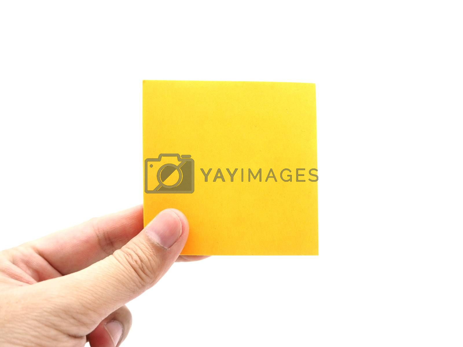 Hand holding an orange paper stick note isolated on a white background.