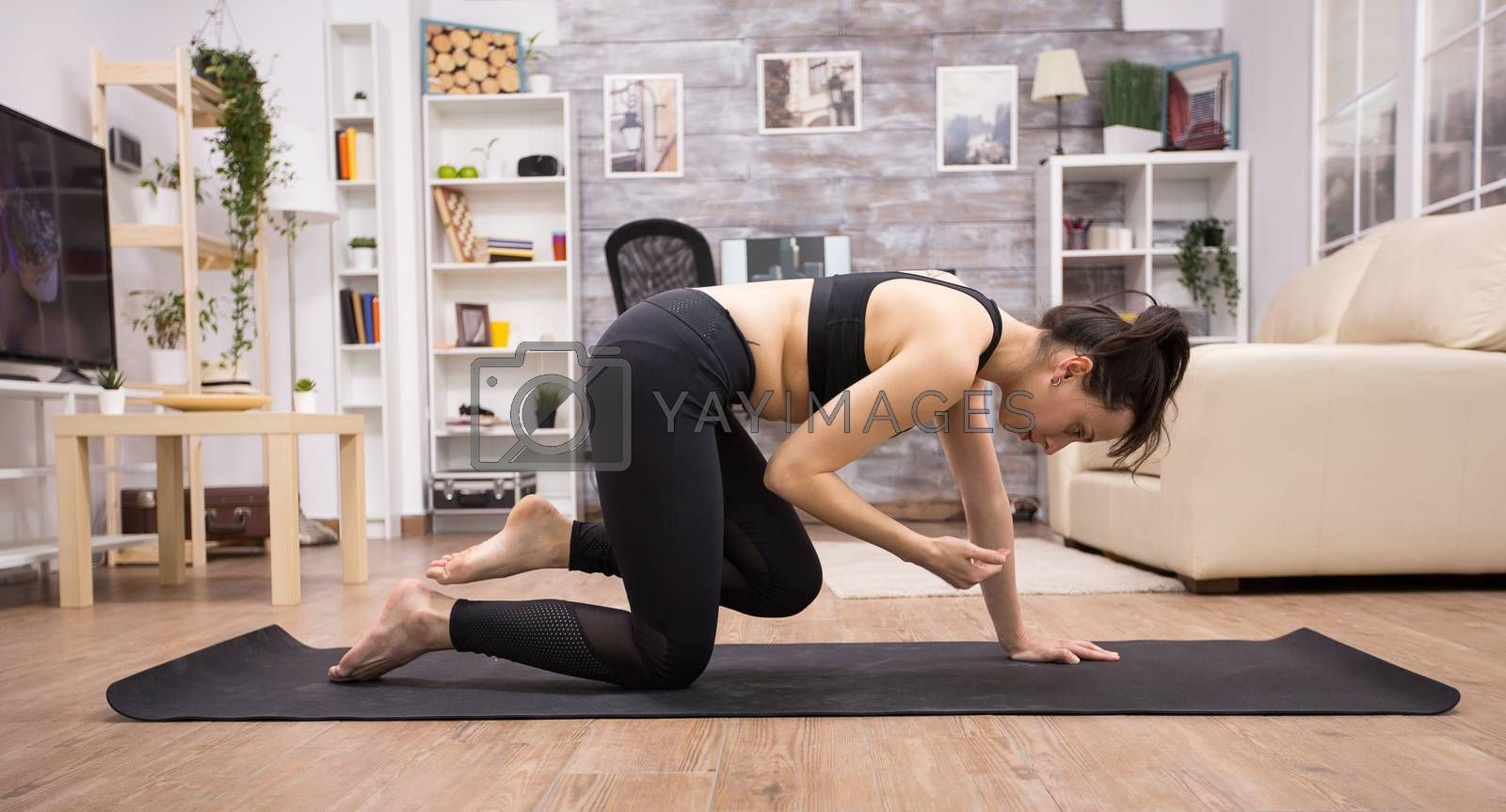 Adult with woman with healthy lifestyle doing yoga pose by DCStudio